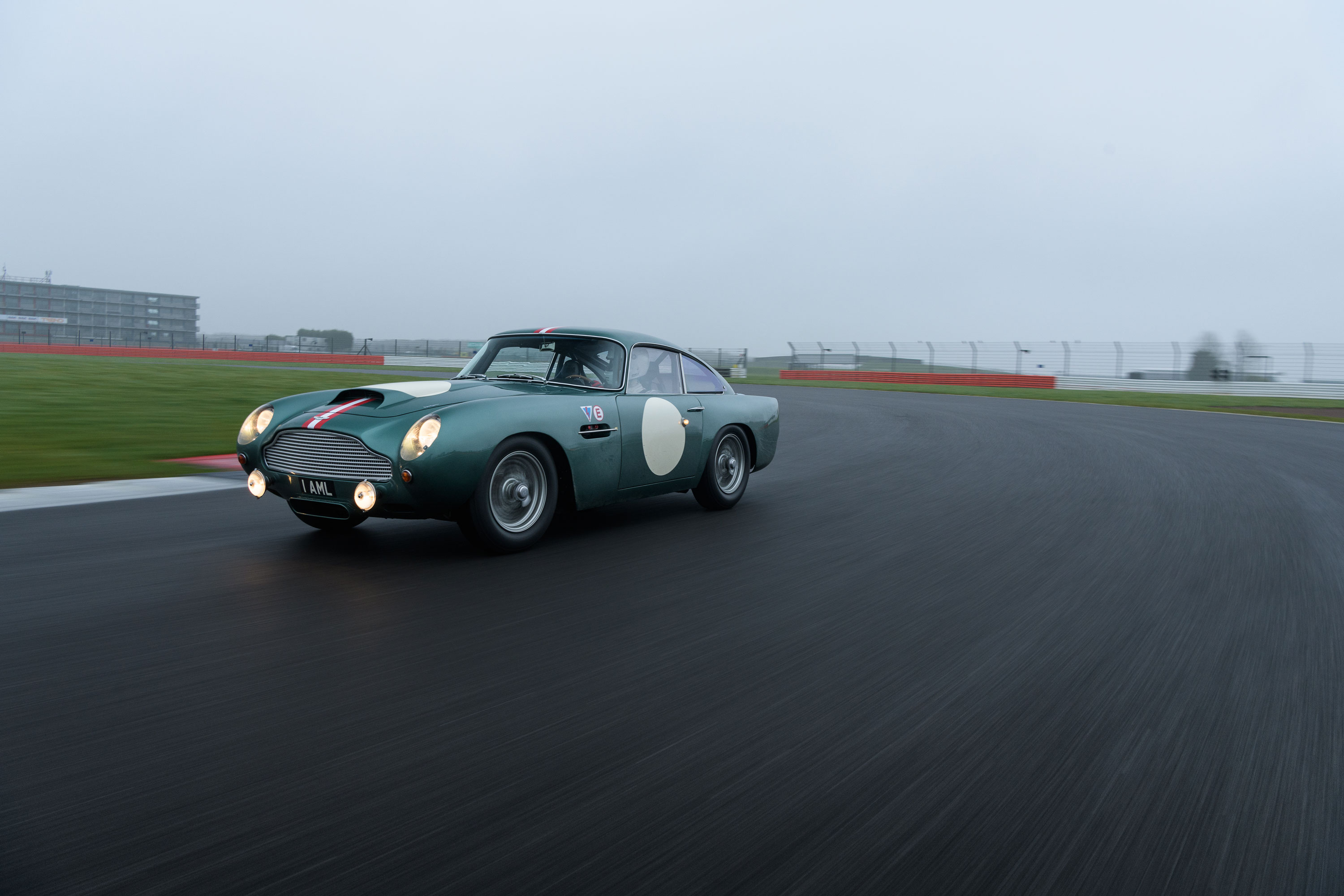 1959 Aston Martin DB4 GT banking right on the track