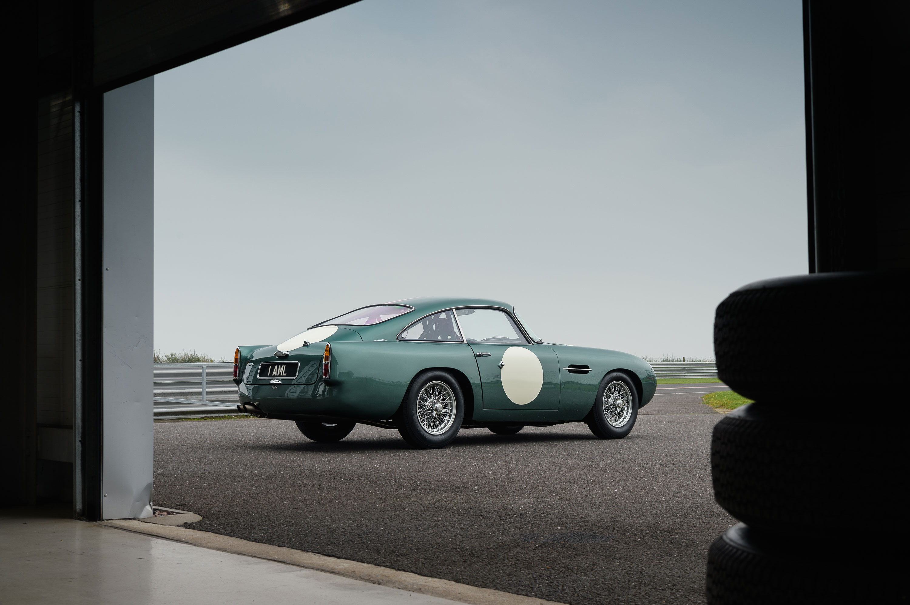 1959 Aston Martin DB4 GT coming out of the garage