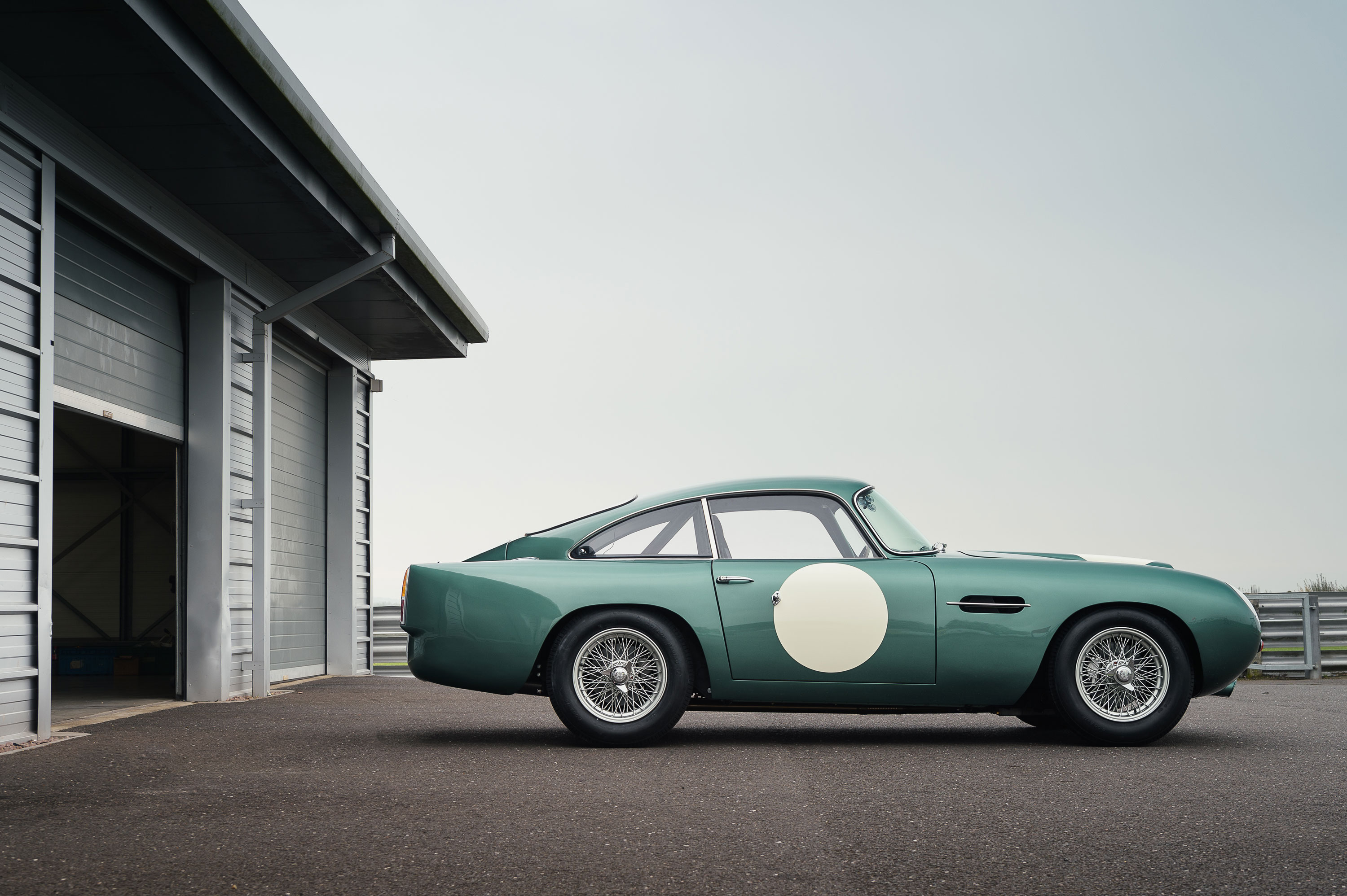 1959 Aston Martin DB4 GT profile by the garage