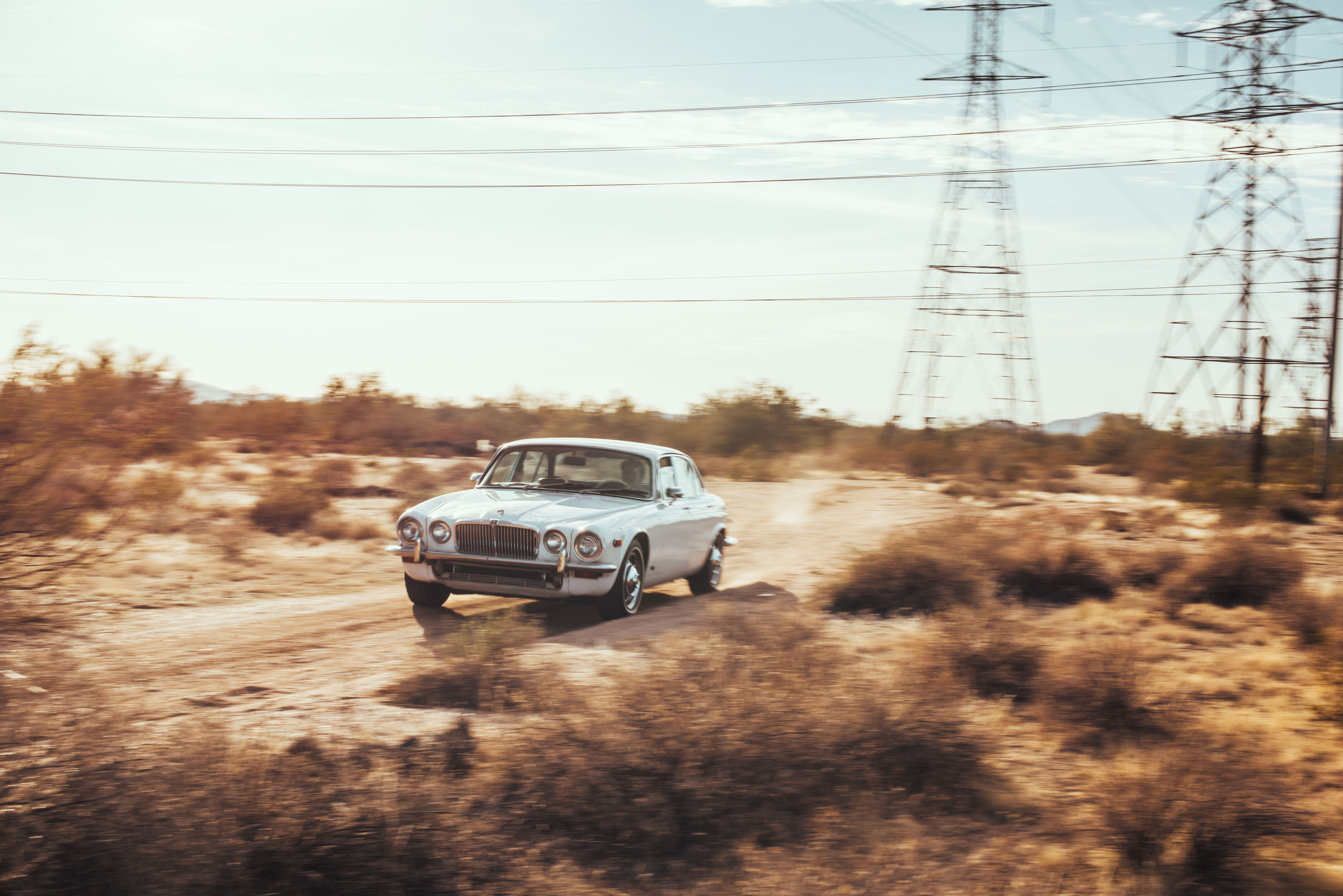 1974 Jaguar XJ6 driving towards the camera