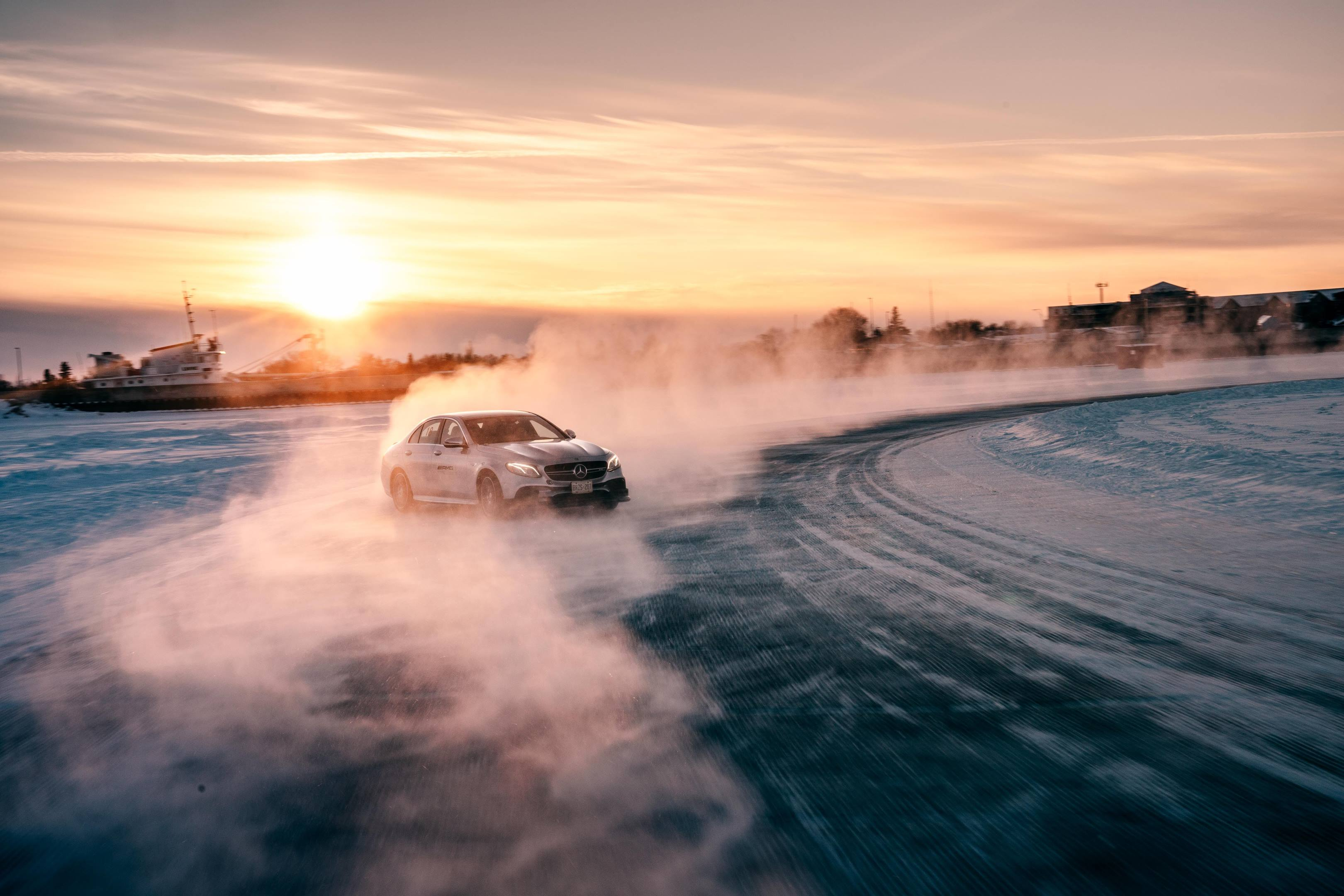 Mercedes-AMG driving on ice at sunset