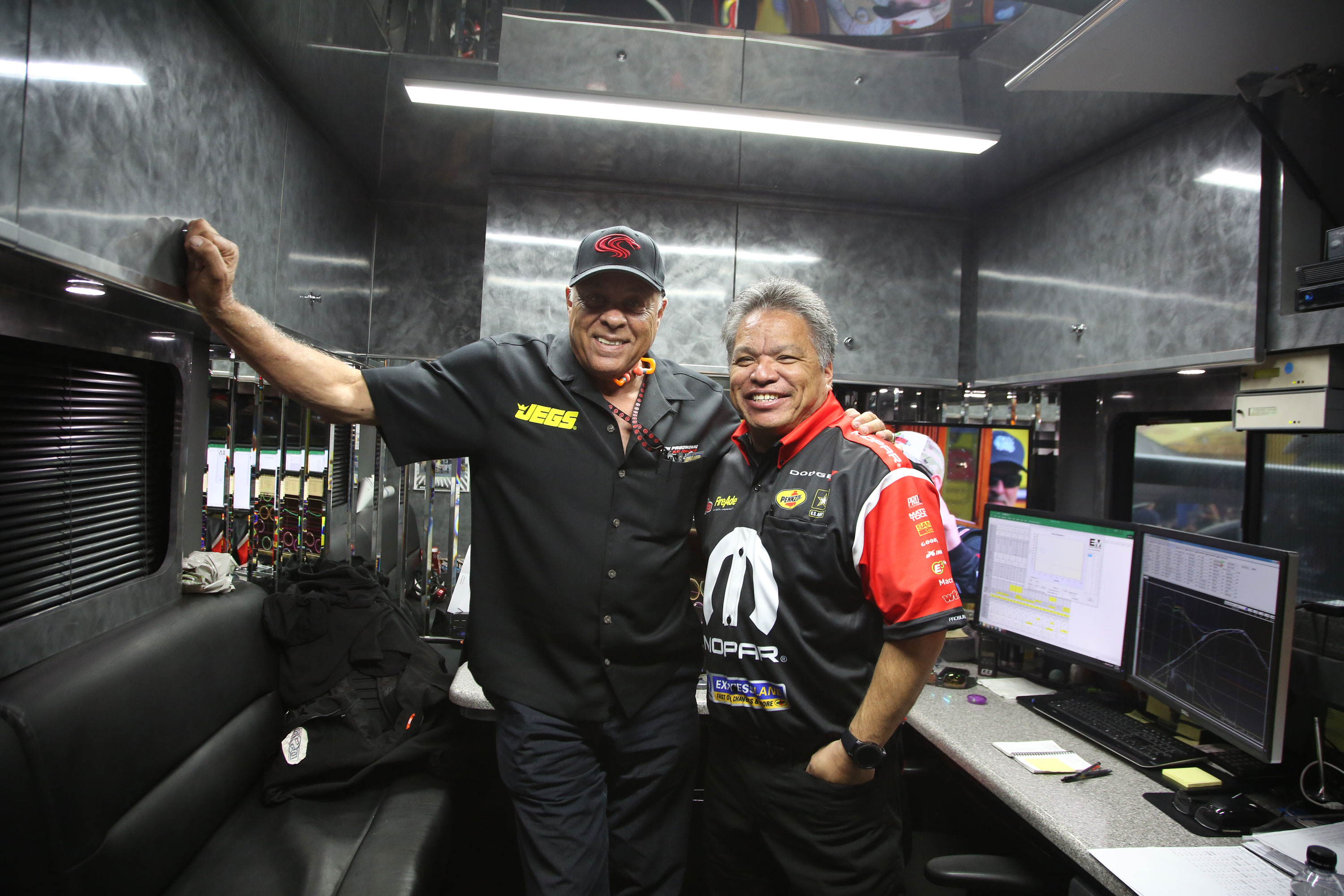 "You'll find former Snake Racing employees all over the pits. Prudhomme poses for a photo with DSR crew chief, Todd Okuhara. ""This guy used to work for me!"""