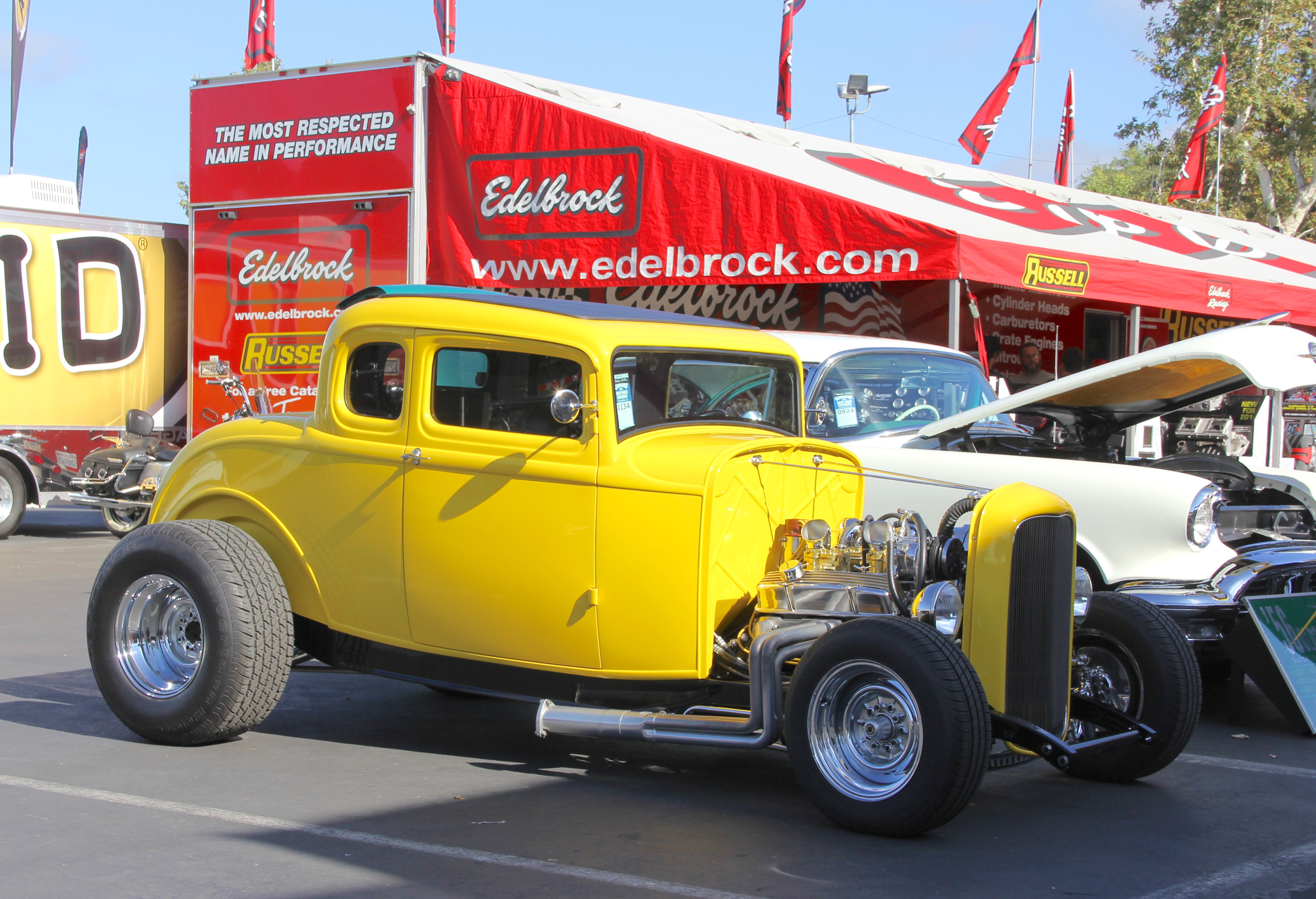 yellow 1932 Ford coupe