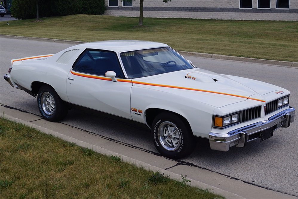 white 1977 Pontiac Can Am on the street