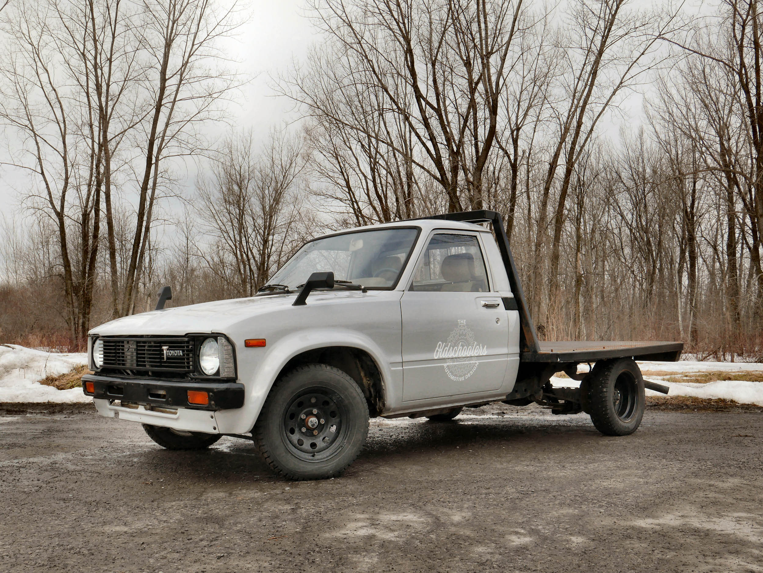 1980 Toyota dually flatbed front 3/4 during winter