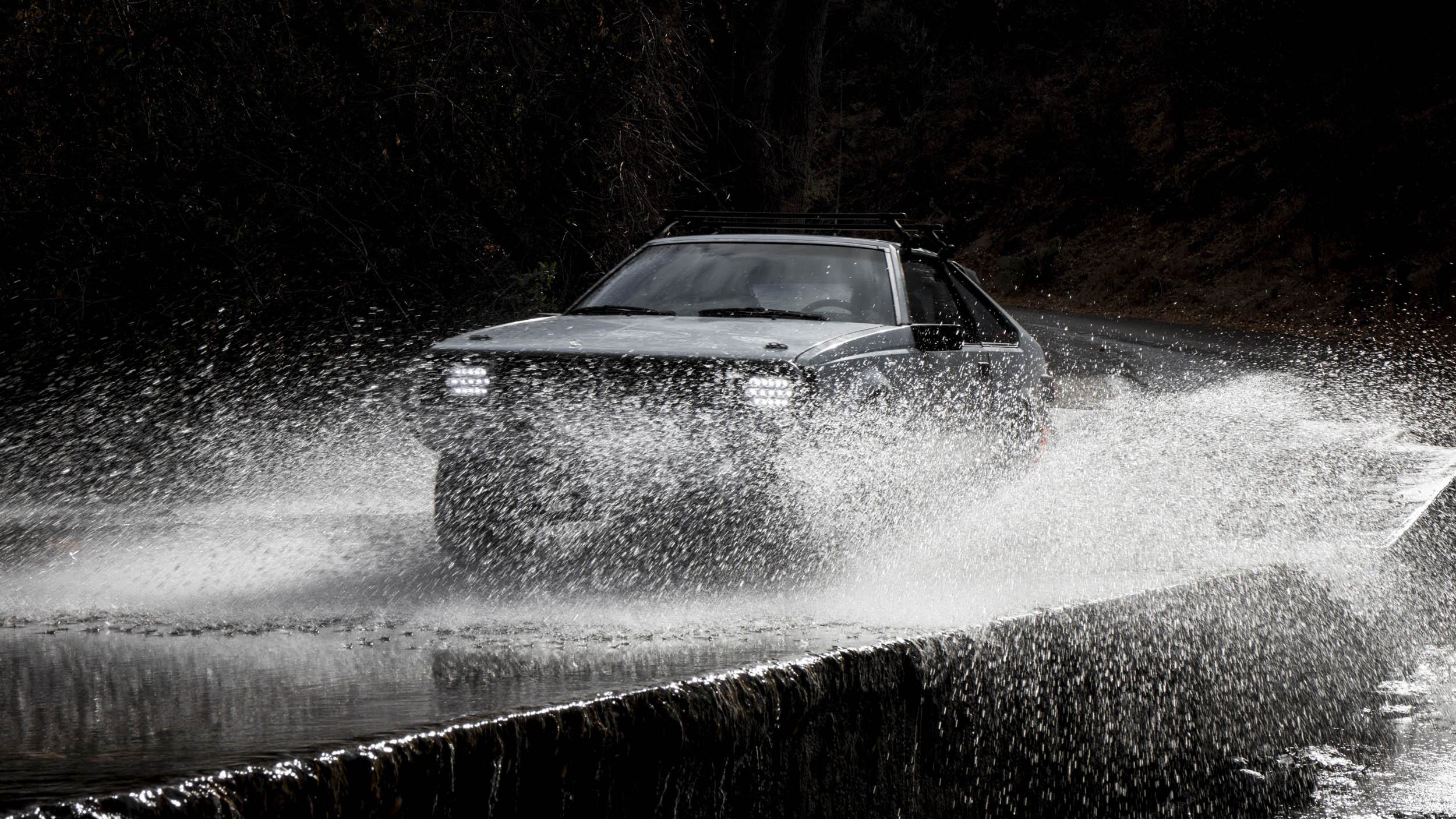 1984 Toyota Celica GT driving through a puddle