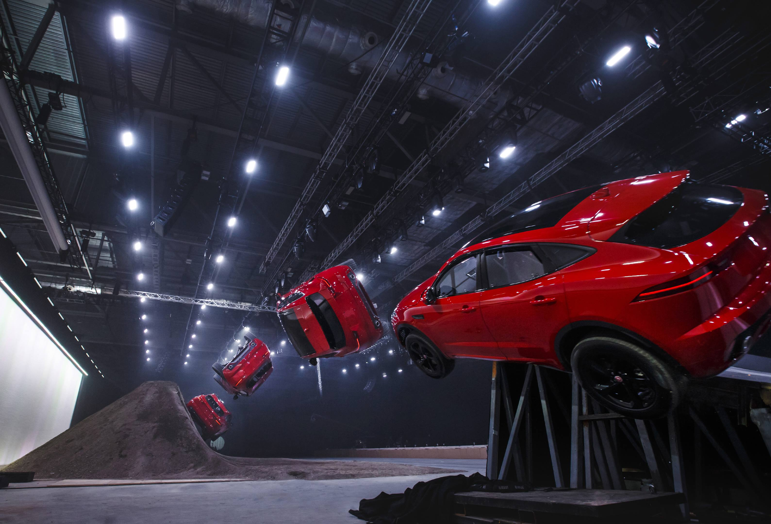 "When introducing the new E-Pace, Jaguar called its stunt a ""barrel roll."" Just as with the Astro Spiral Jump, the ramp dropped away, and a fifth wheel kicked the rear end skyward."