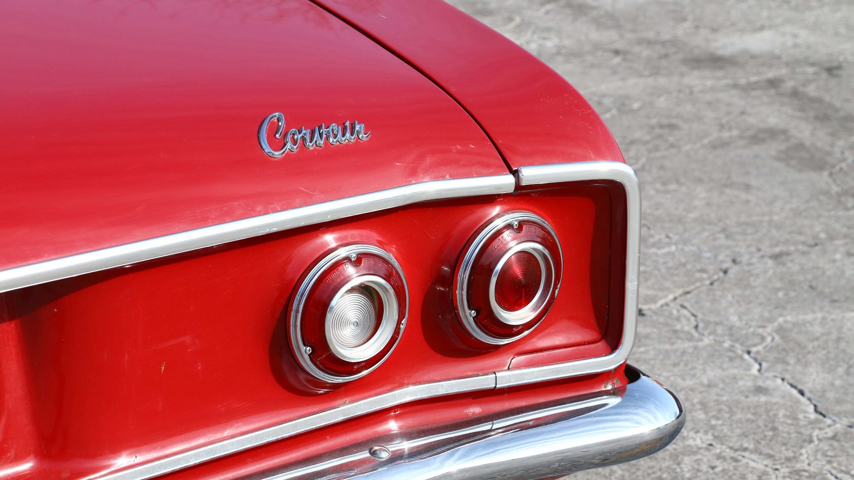 1965 Chevrolet Corvair tail light and badge detail
