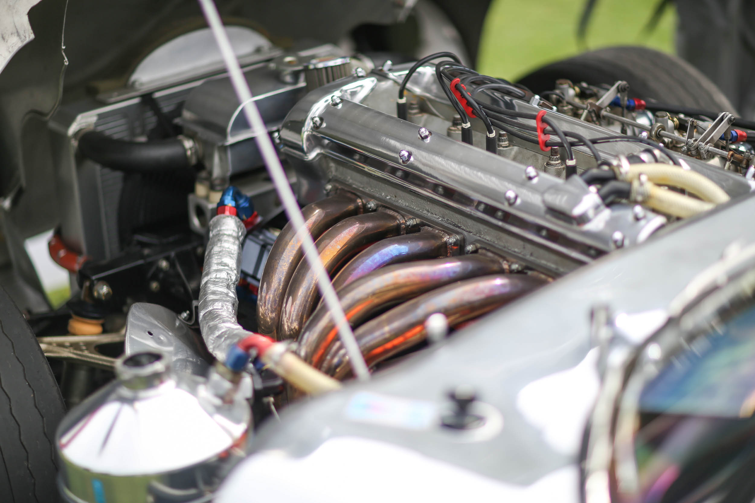 We found this beautiful inline-six under the long hood of a Jaguar E-type.