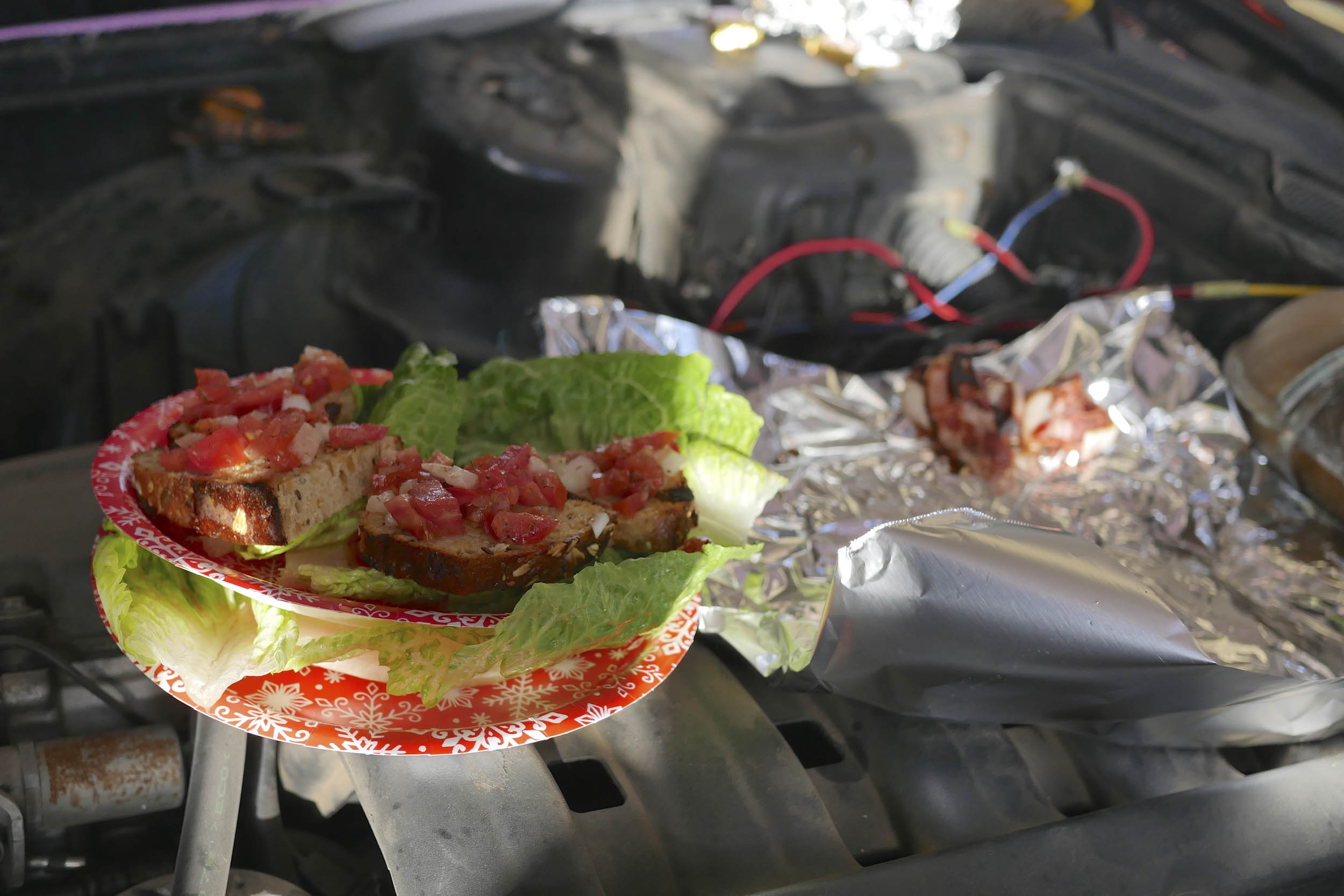 food cooked on a car engine