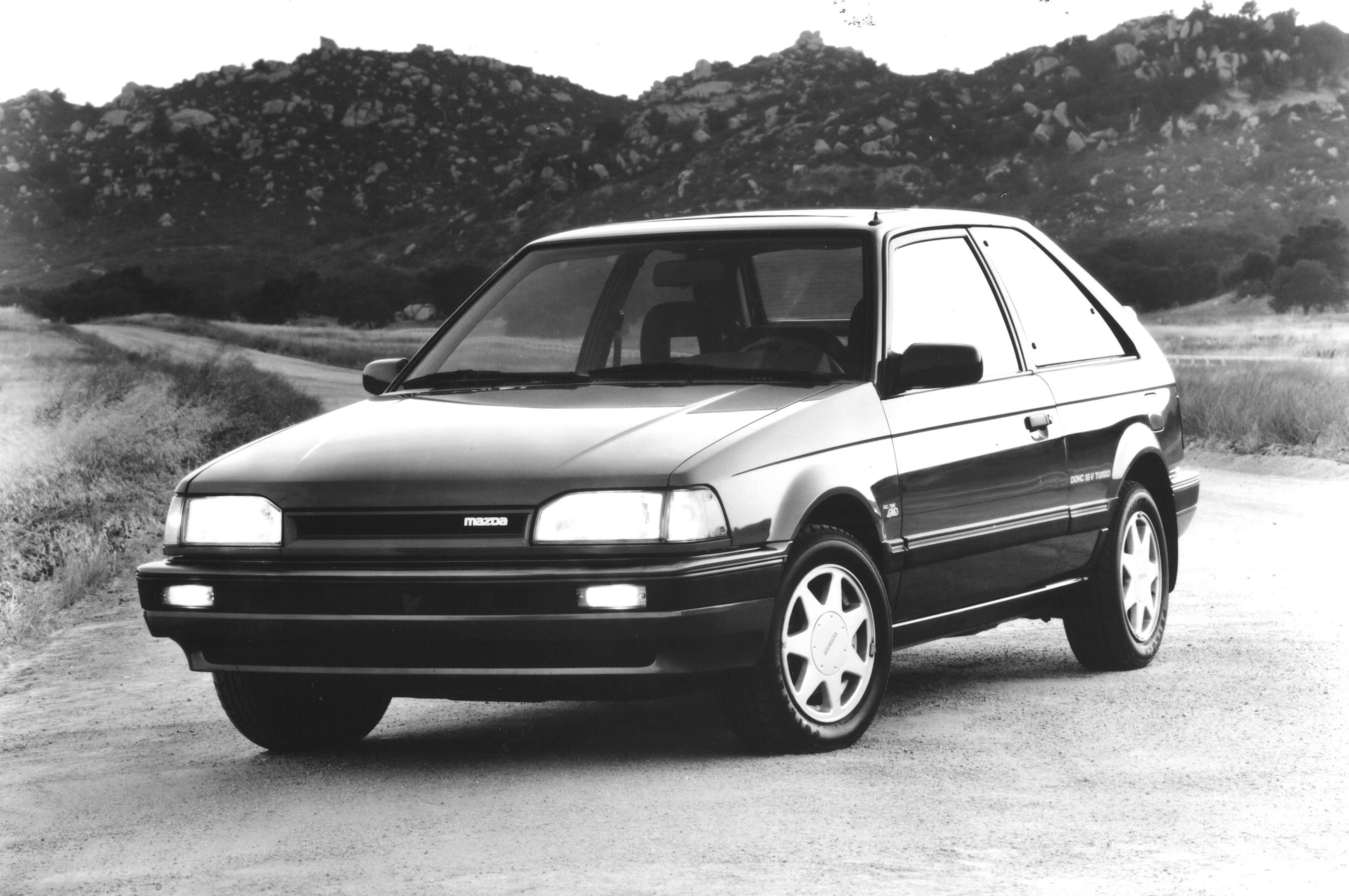 black and white 1988 Mazda 323 GTX Front