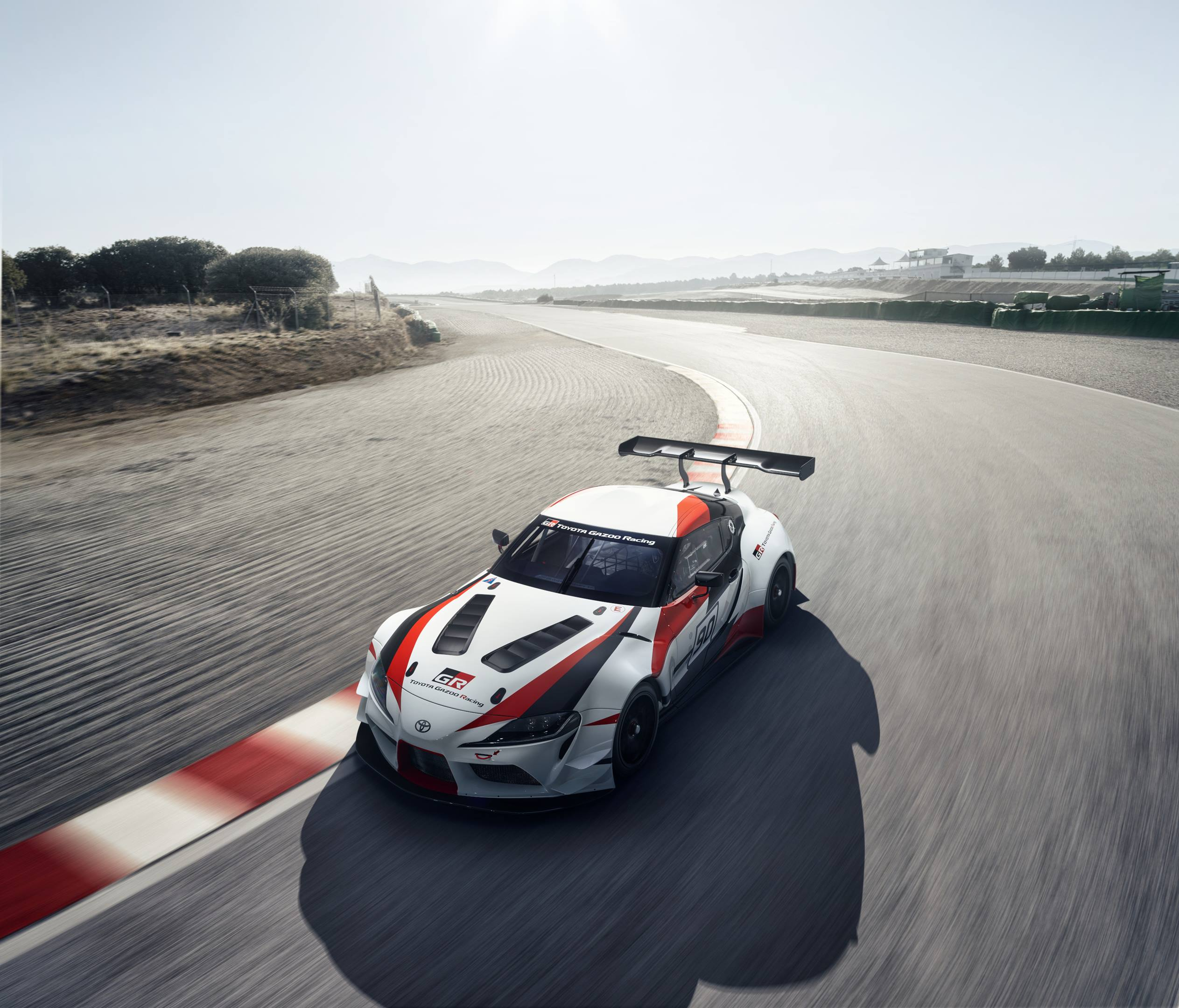Toyota Supra concept racing around the track