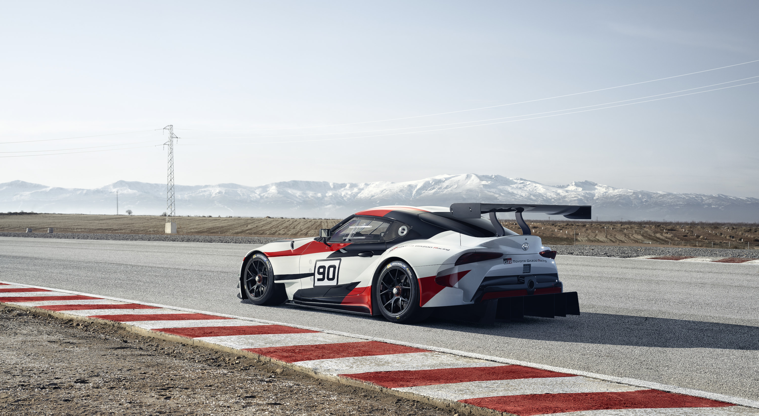 Toyota Supra racing concept rear 3/4 on the track