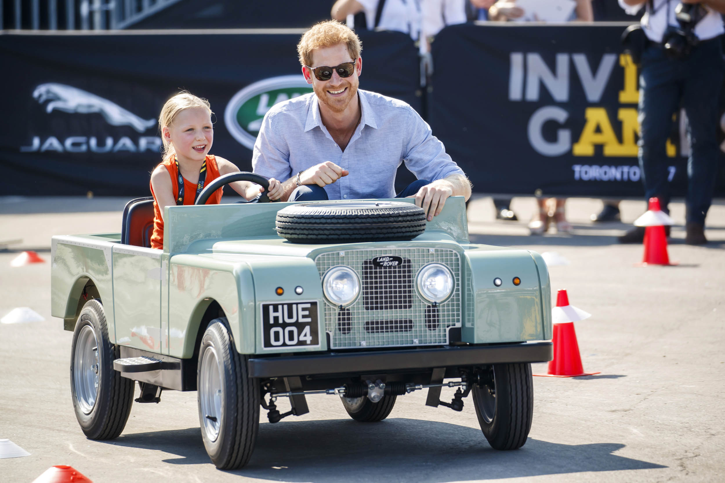 Prince Harry in a Land Rover peddle car