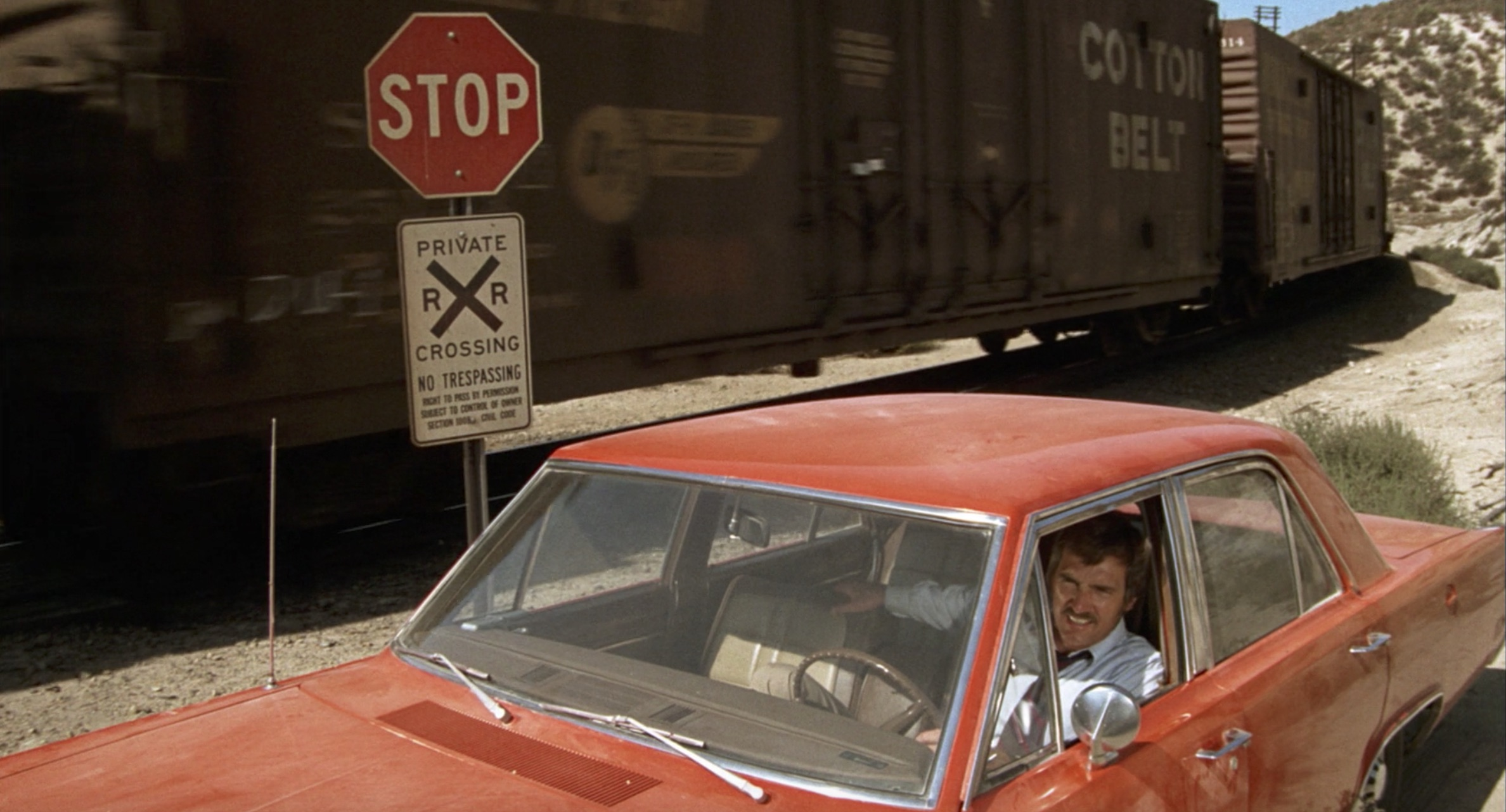 1971 Plymouth Valiant against a moving train in Duel