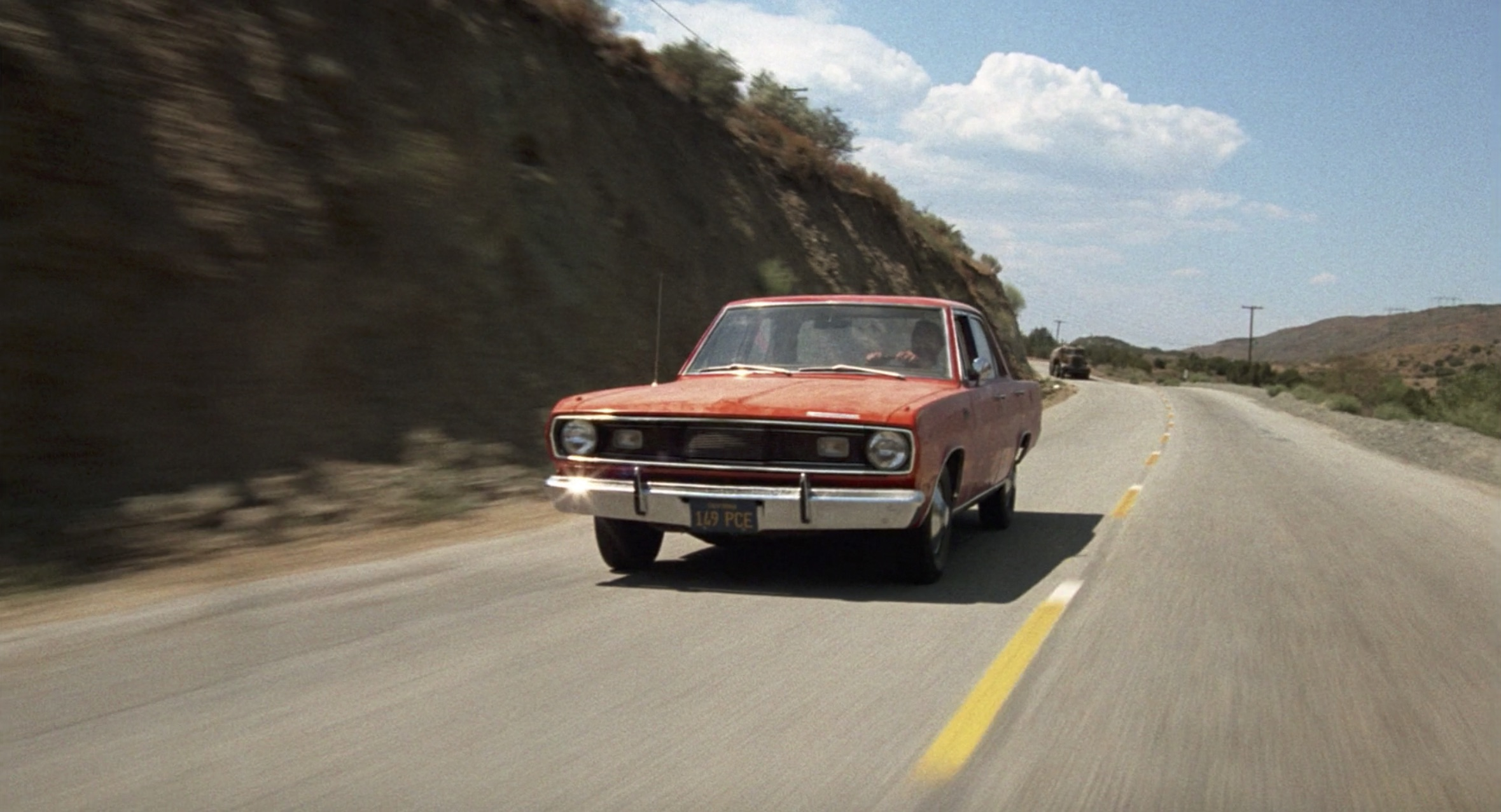 1971 Plymouth Valiant driving down the highway Duel