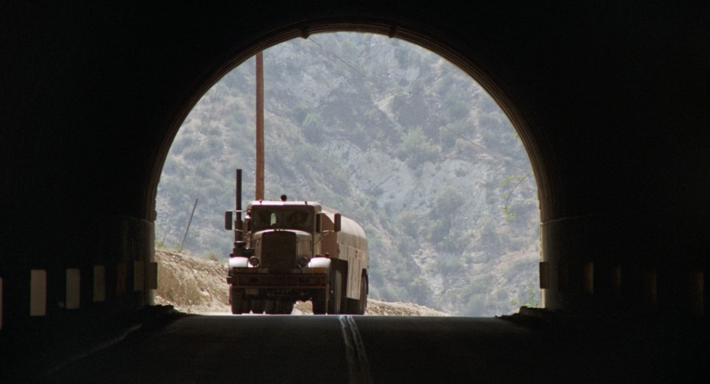1955 Peterbilt 281 tanker driving through a tunnel