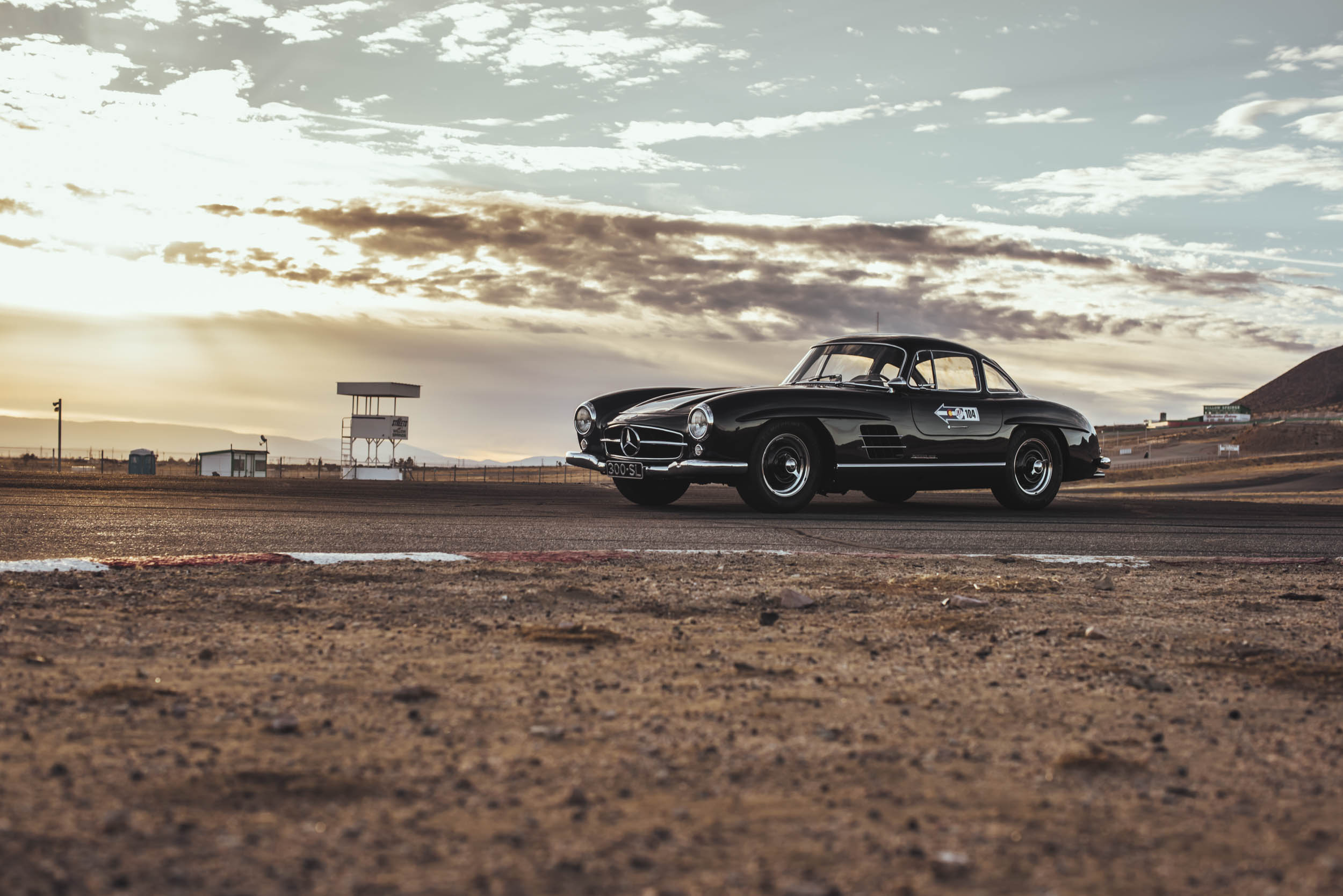 black 1955 Mercedes-Benz 300 SL front 3/4 at sunset