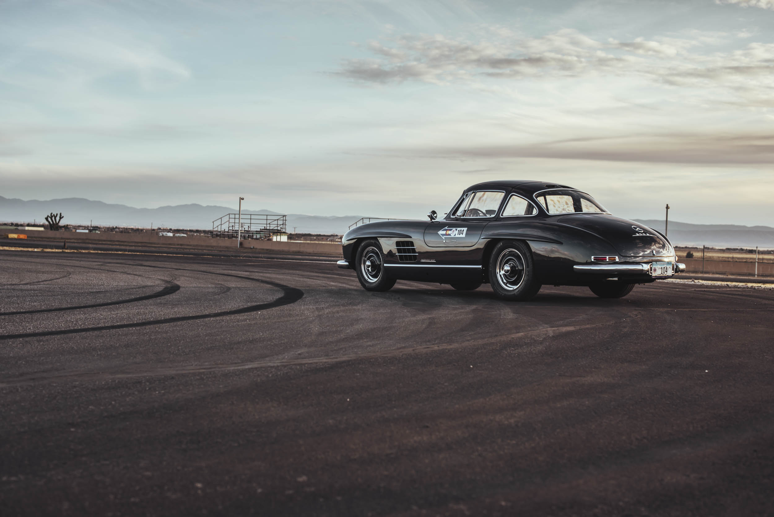 1955 Mercedes-Benz 300 SL Gullwing rear 3/4 driving on the track