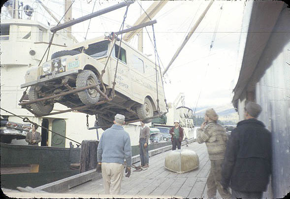 1957 Land Rover being pulled off the boat