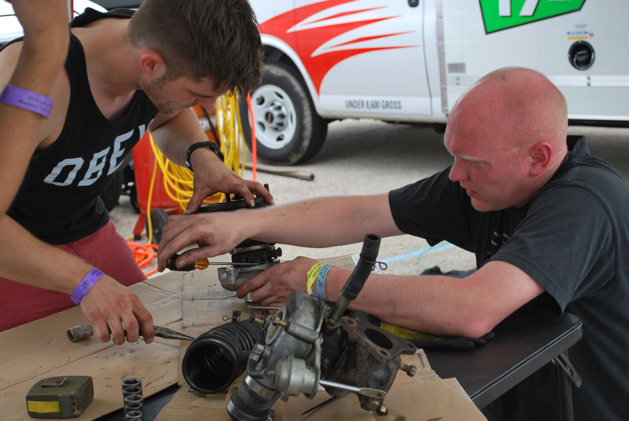 working on Lemons race car in the paddock