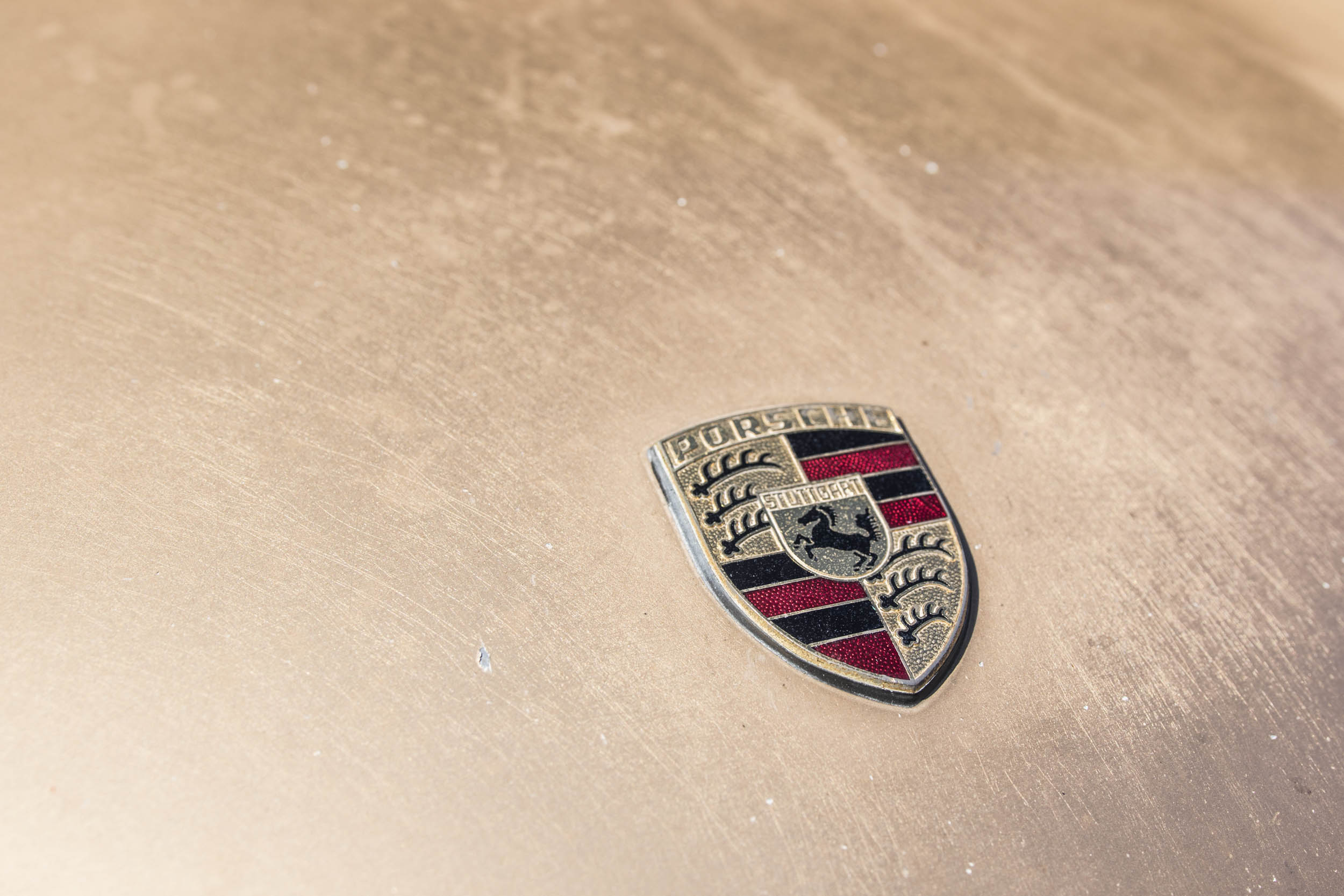 Porsche badge on 911 hood