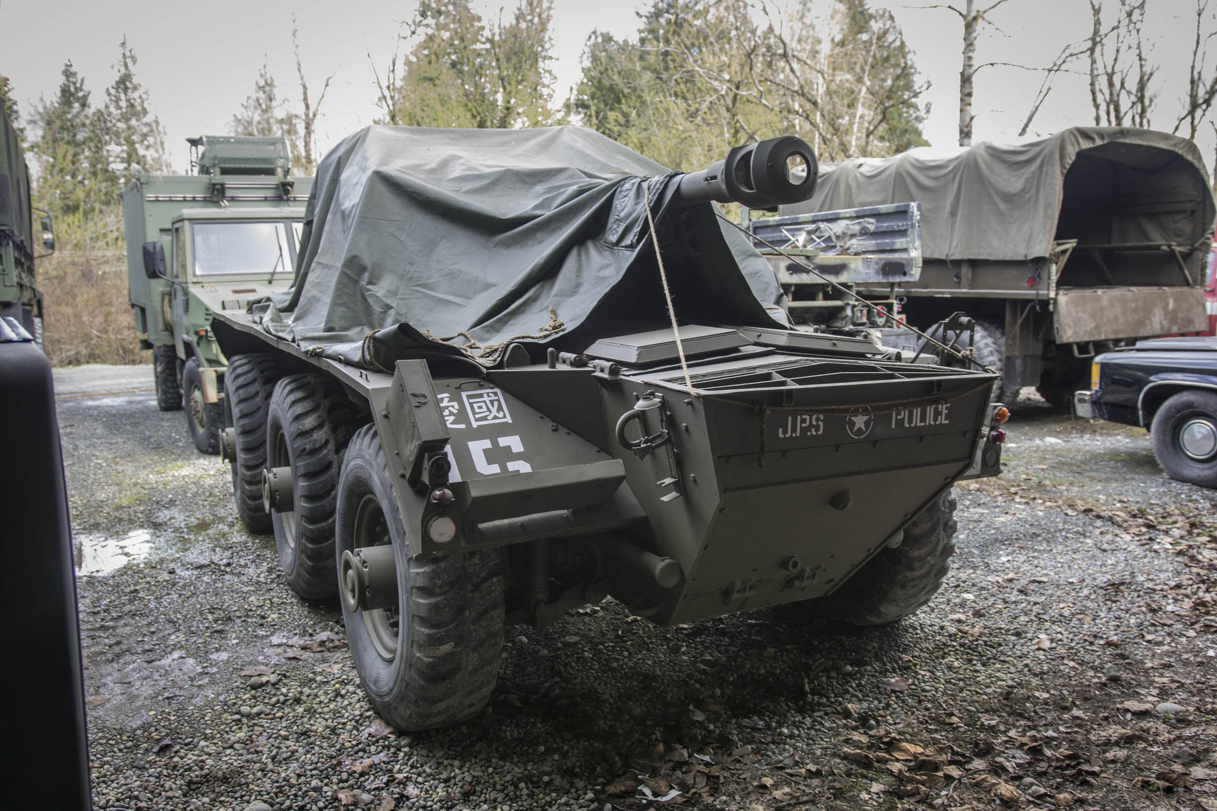 Covered by a tarp, this 6x6 armored car is another cast member of The Man in the High Castle.