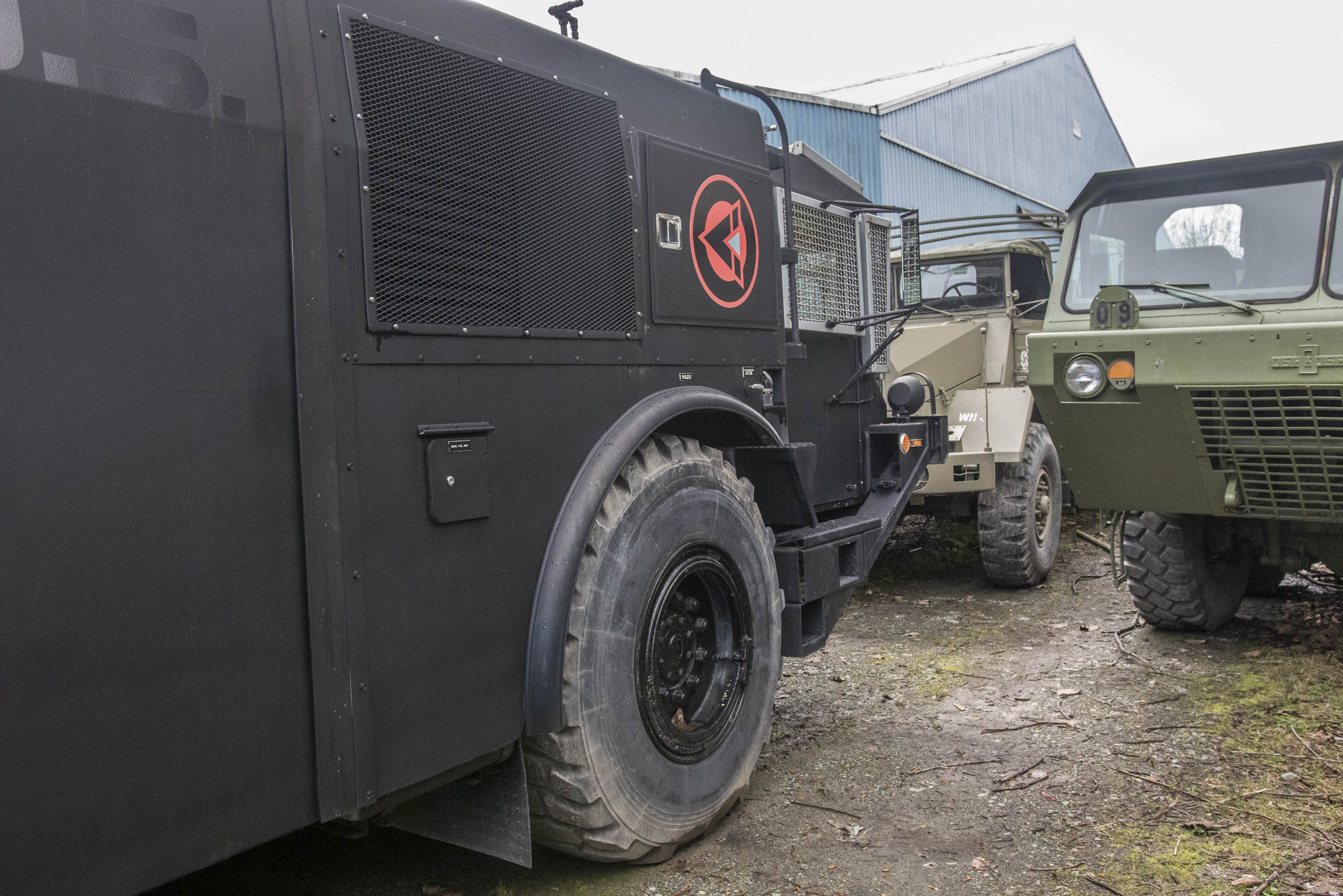 From left to right, a riot-control vehicle built for Canadian security forces at the G8 summit; a cargo truck from The Man in the High Castle, dressed up to look like a German military vehicle; and an Oshkosh high-mobility heavy hauler.