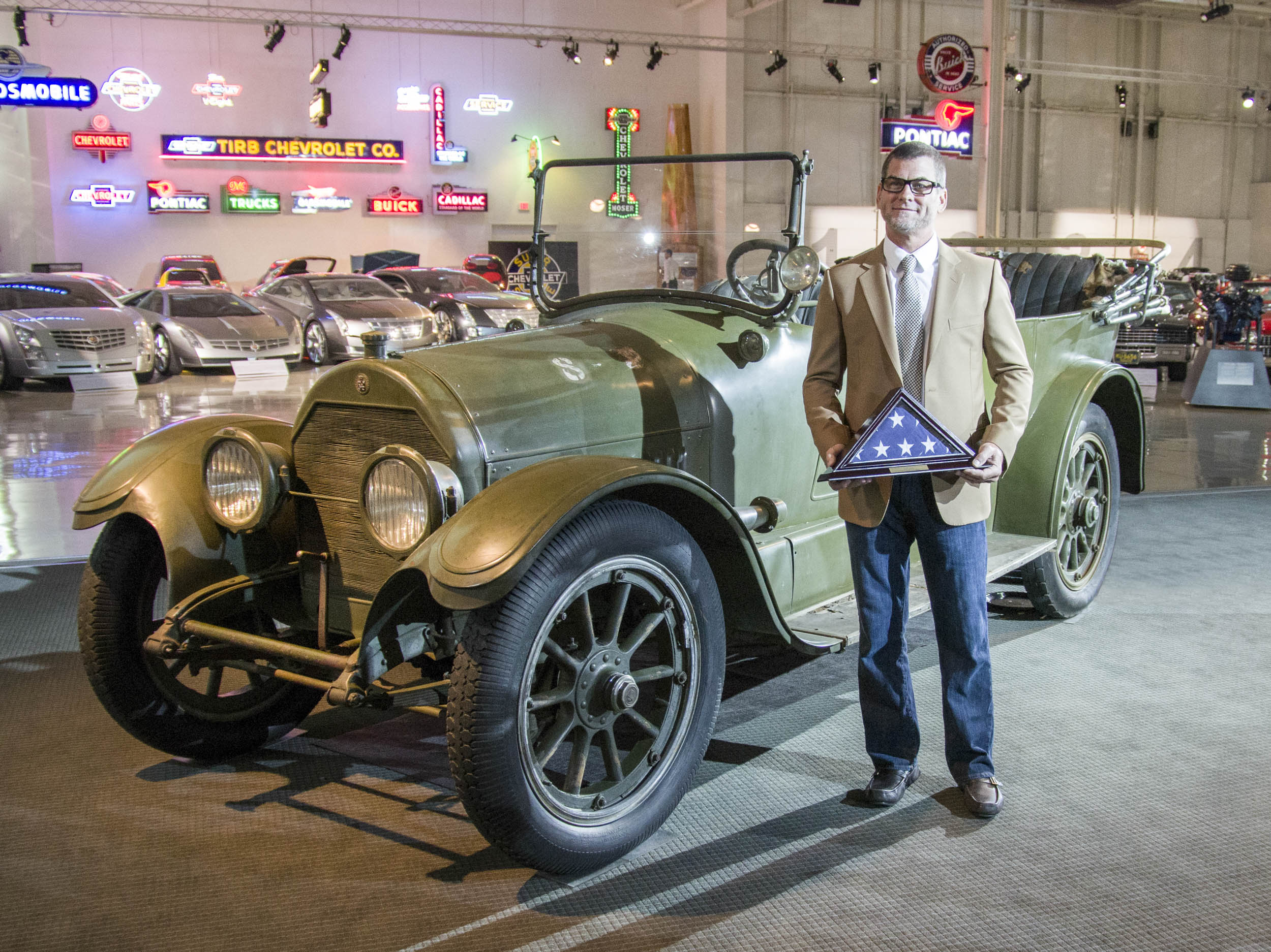 "The 1918 Cadillac Type 57, Marc Lassen and his ""Stewardship of Automotive Heritage Award"" at the GM Heritage Center, July 2014."