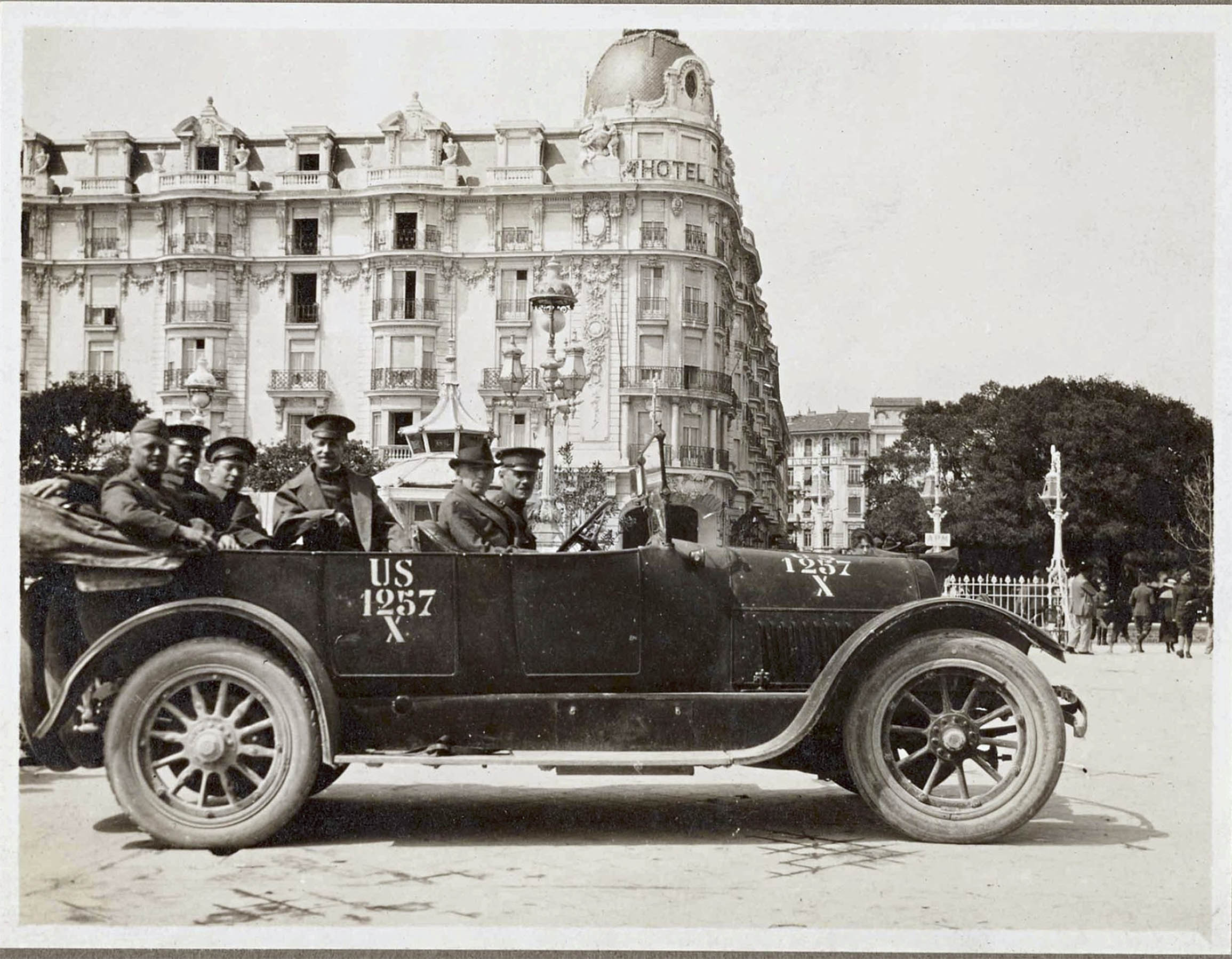 Dr. Denison at the wheel of his 1918 Cadillac Type 57 in Nice, France 1918. According to Mark Gessler, president of the Historical Vehicle Association, the U.S. military numbering on the car indicates that it was (1) a passenger vehicle, (257) the 257th passenger vehicle to arrive in Europe for support of the war effort, and (X) a privately-owned vehicle. Marc Lassen, the current owner of the Cadillac, believes the car was wearing its original blue paint in this photo.