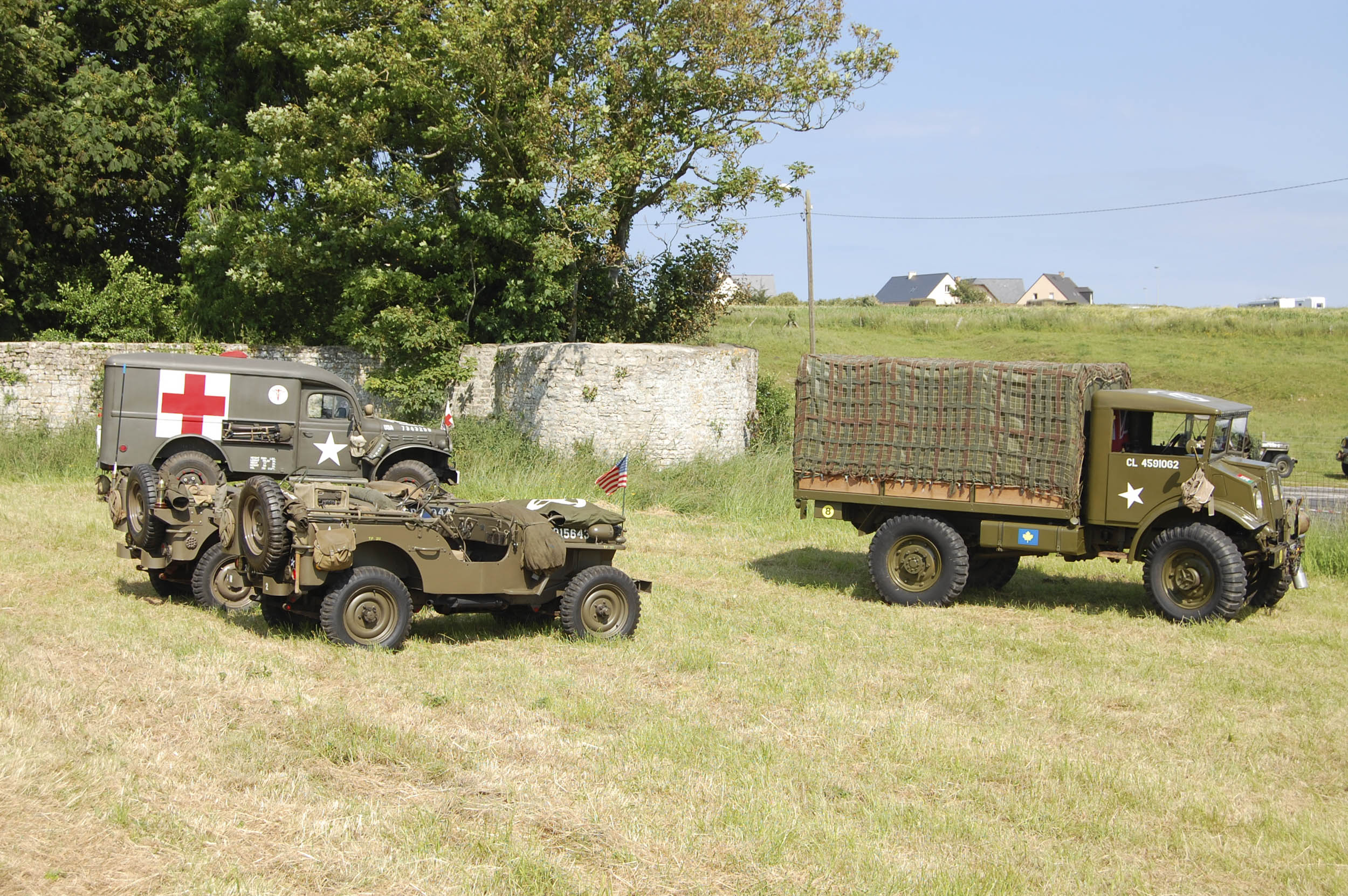 WW2 Jeep, Dodge WC54 ambulance and a Ford CMP cargo truck from WW2.