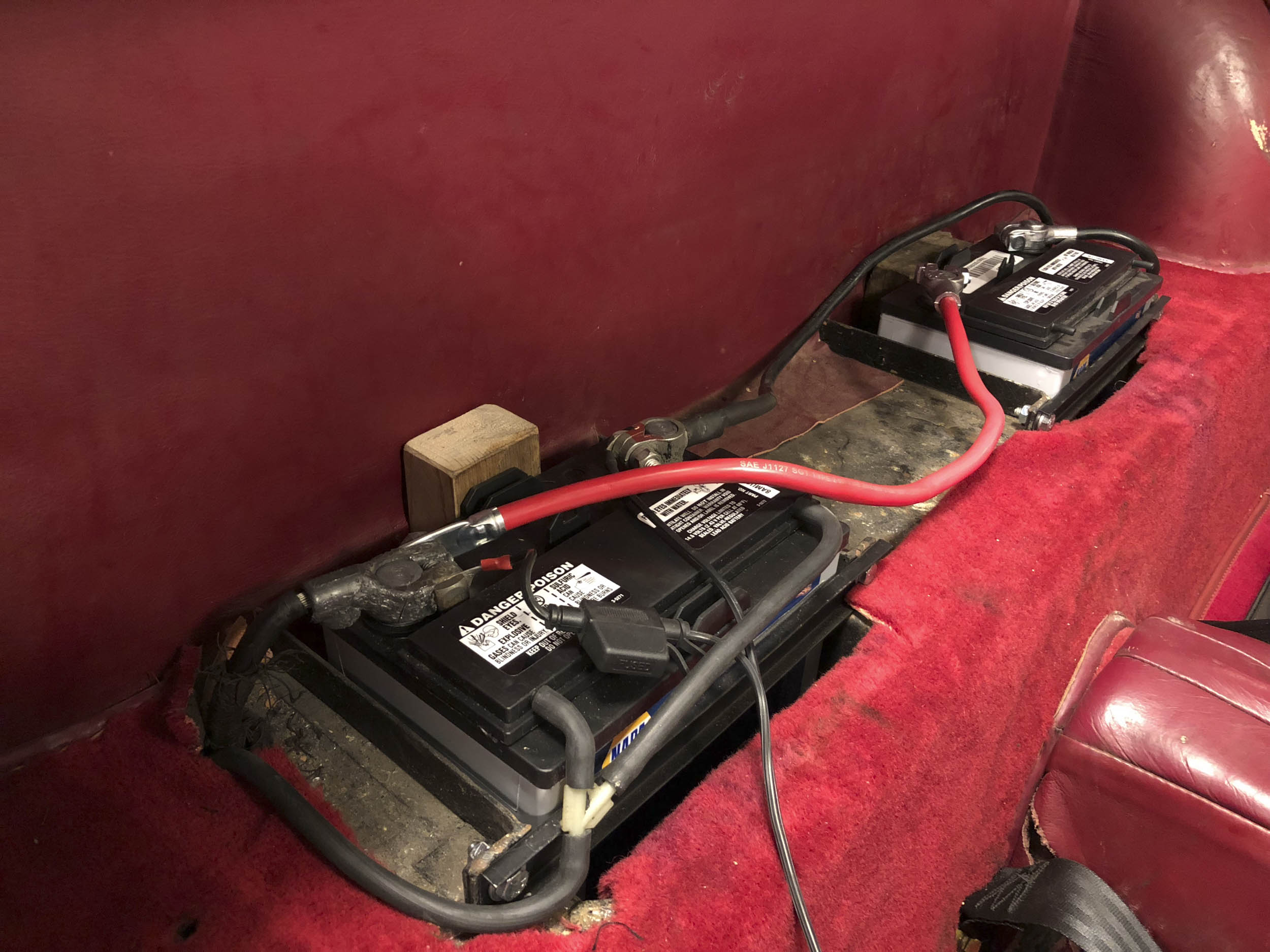 XK120 with dual Miata 12V batteries hidden in stock dual 6V boxes