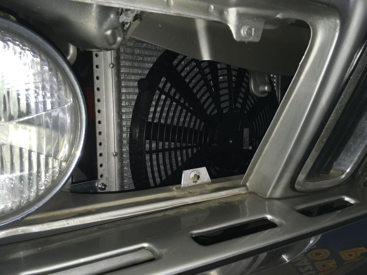 Condenser with auxiliary cooling fan.