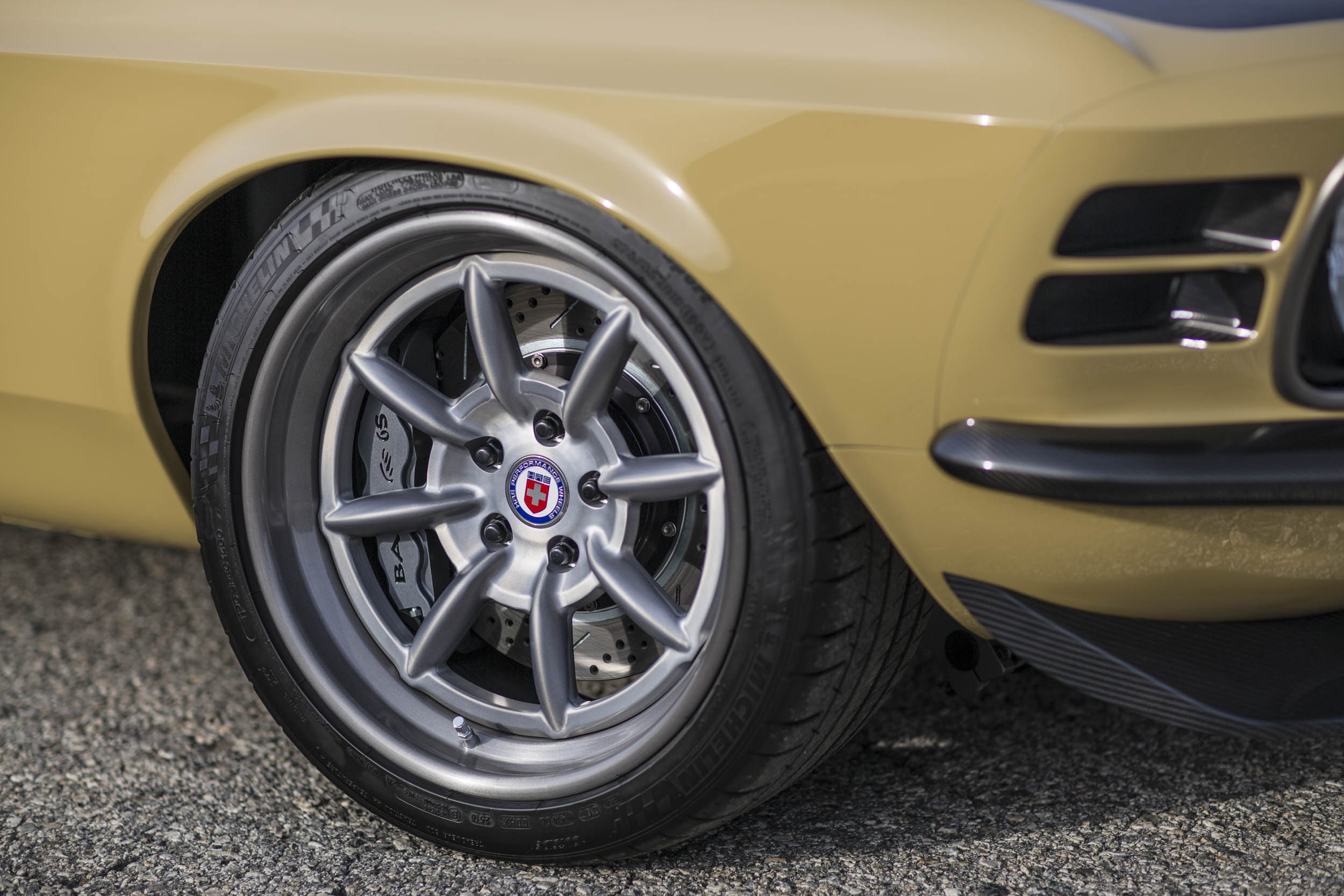 A custom set of HRE wheels are inspired by classic Minilites. Behind them are Baer brakes and a Detroit Speed front suspension.