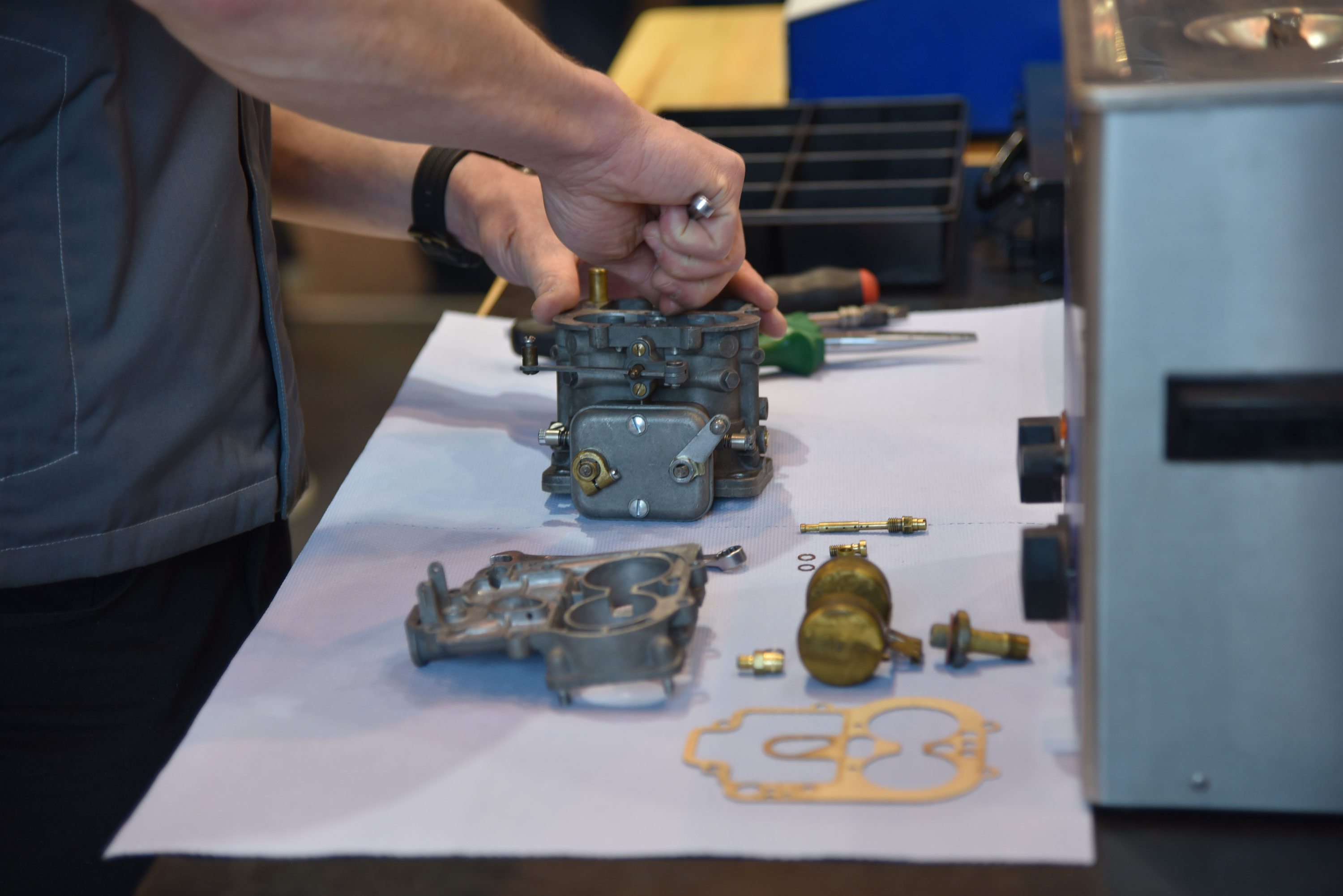 The impressive display of Eberlein Ferrari, a big-time new and classic Ferrari dealer in central Germany, featured a couple of techs who seemed to be disassembling and assembling the same already restored carburetors over and over in a demonstration of the company's skills.