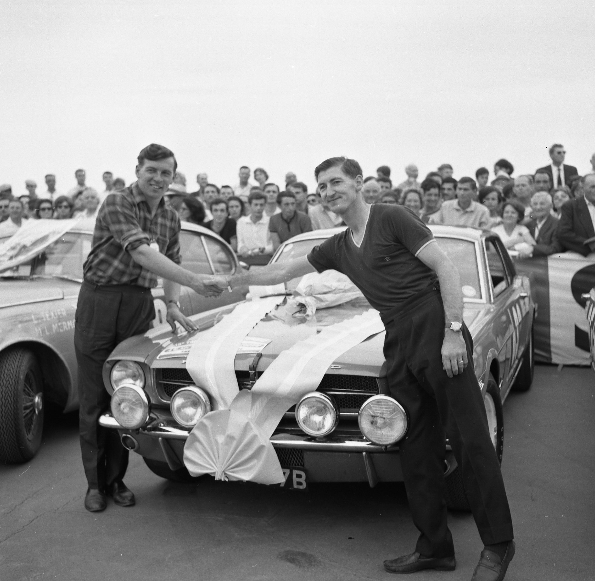 British drivers Andrew Cowan (left) and Peter Procter with the 1965 Mustang that won the Touring Class in the 1964 Tour de France Automobile.