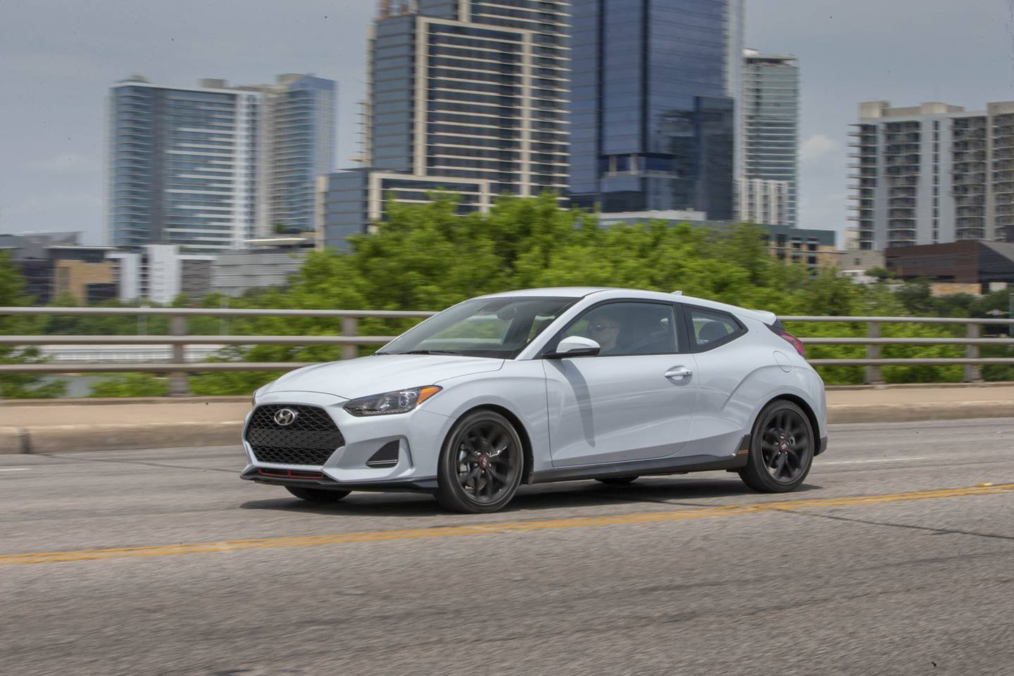 white 2019 Hyundai Veloster front 3/4 driving