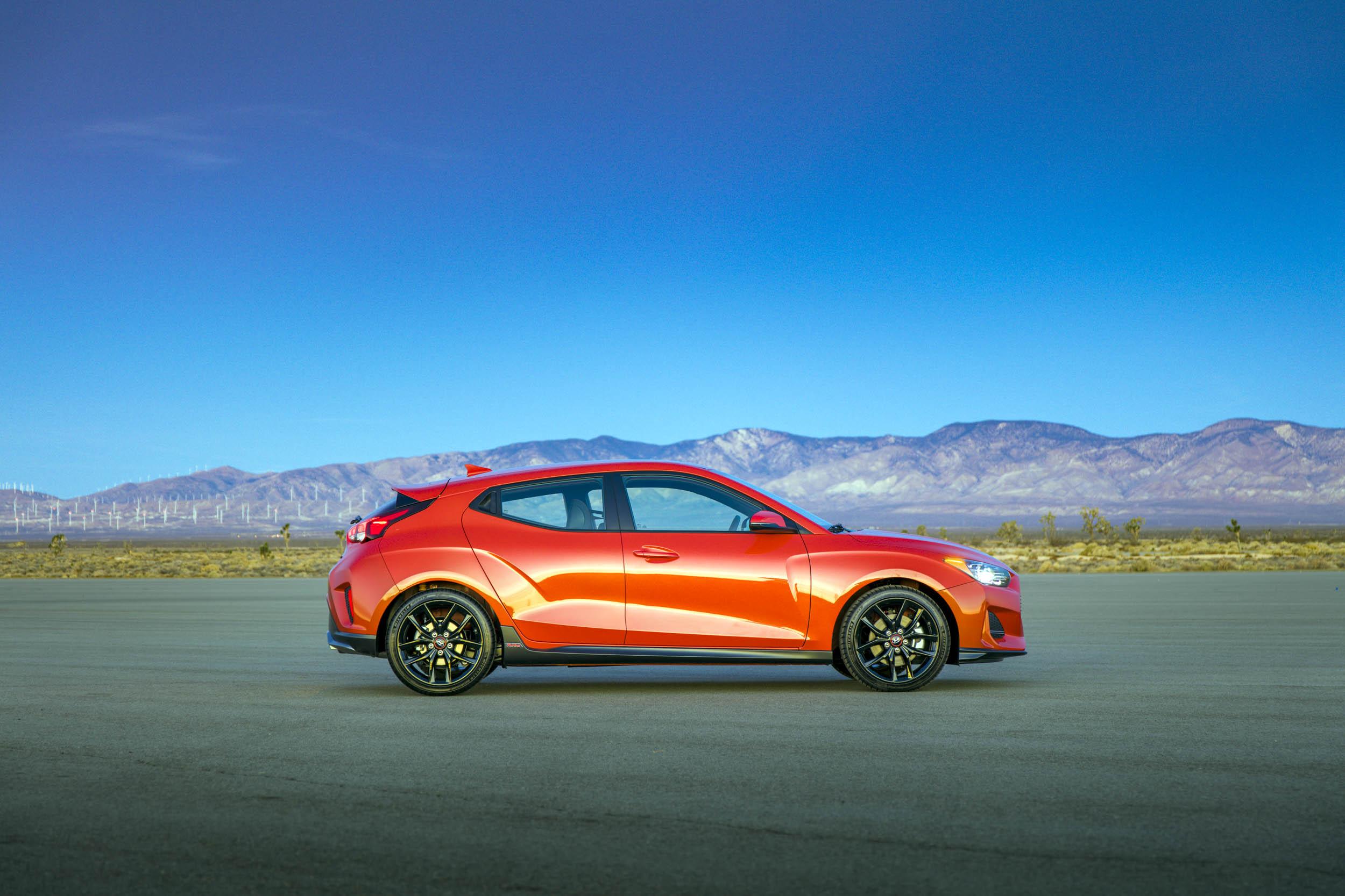 red 2019 Hyundai Veloster profile in the desert