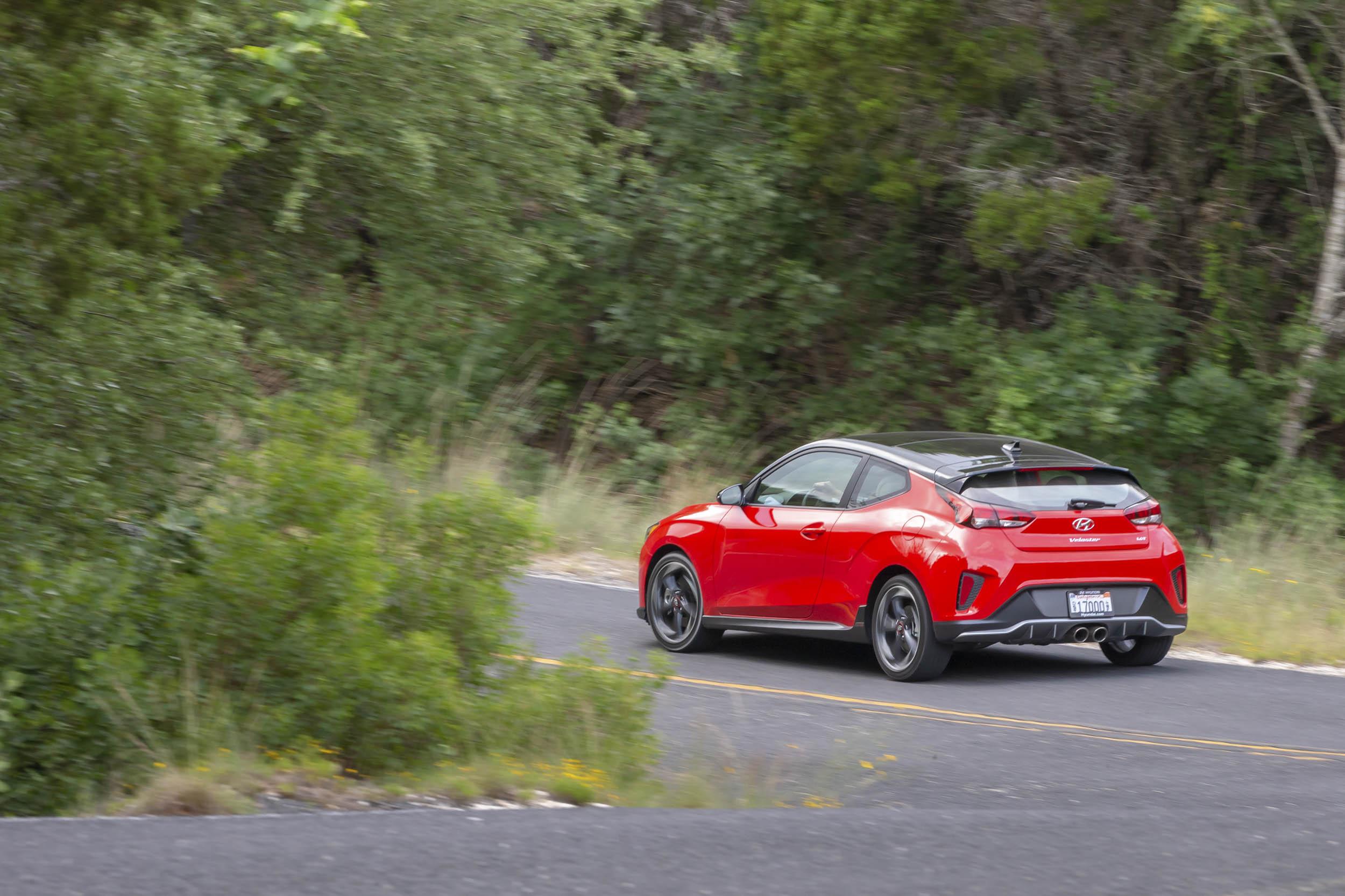 2019 Hyundai Veloster driving around a corner