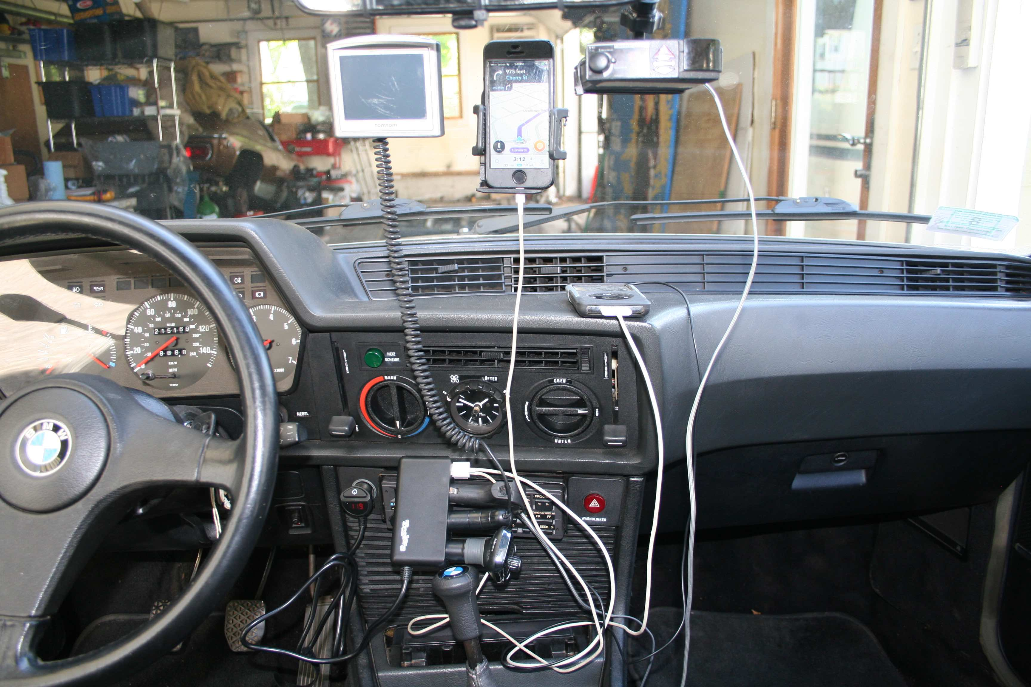 It wasn't that long ago when I had both the GPS and the phone on the windshield, and the power cord configuration literally looked like this (although I'm letting the cigarette lighter adapter box dangle off the dashboard for dramatic effect.