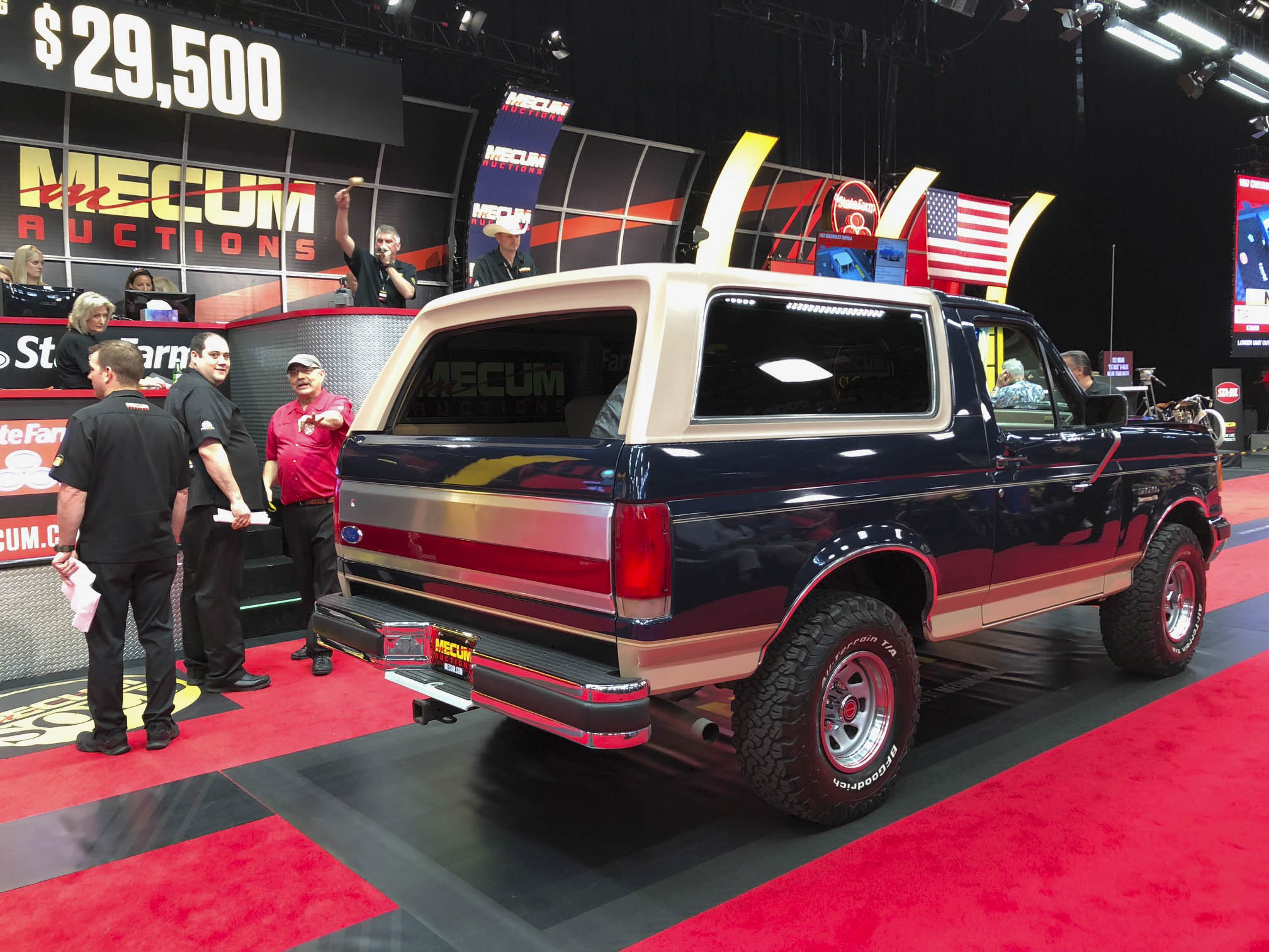 1989 Ford Bronco crossing the block at Mecum