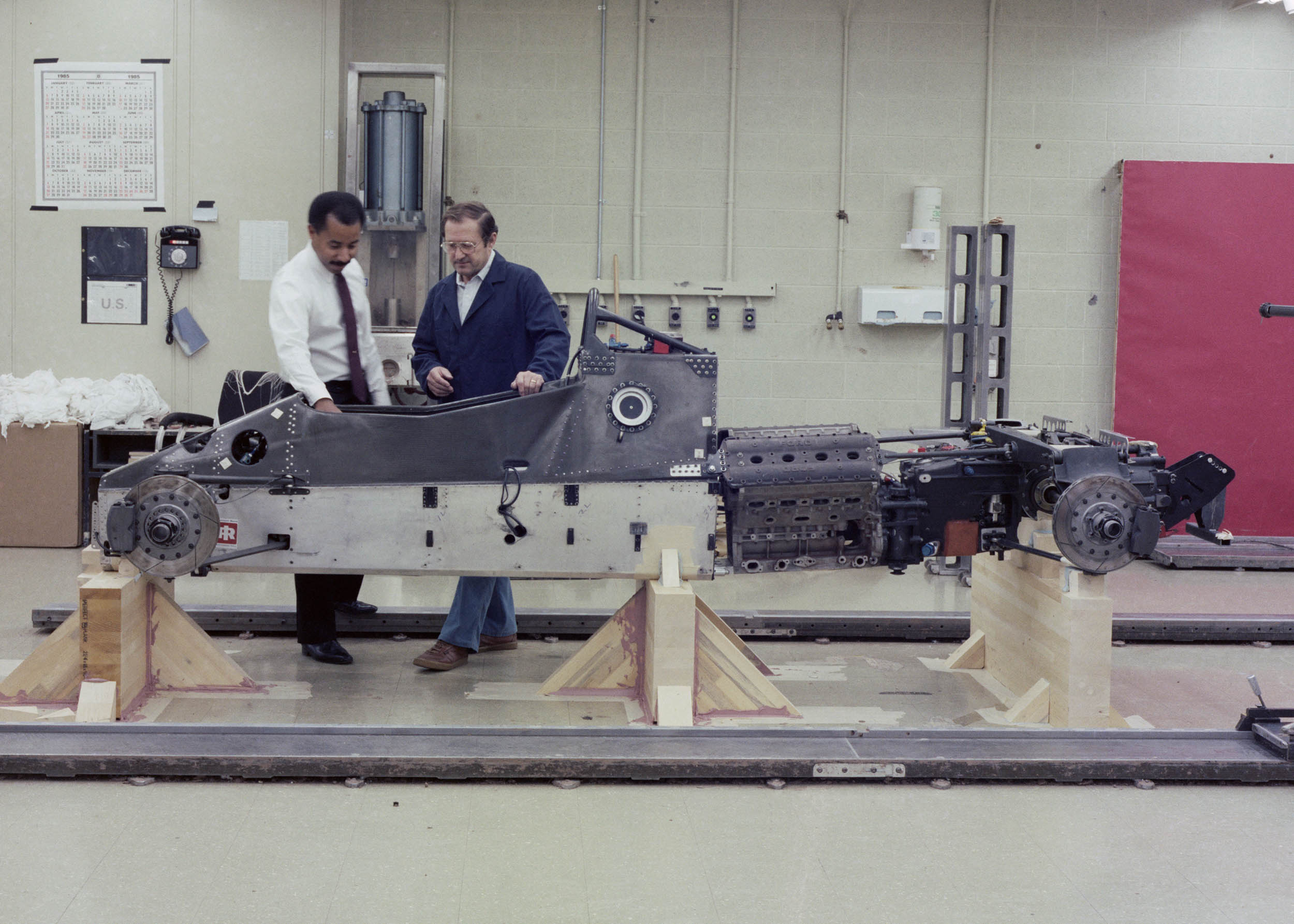 Ed Welburn next to the Oldsmobile Aerotech Indy Record Car Scale Model in 1984