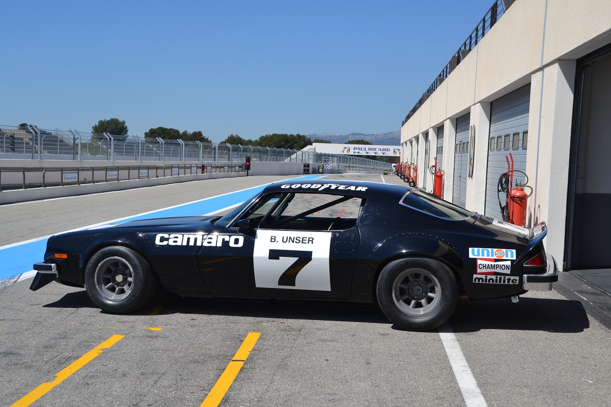 Bobby Unser, one of three drivers to win an IROC race in 1974 in the #7 car, also won that season's championship.