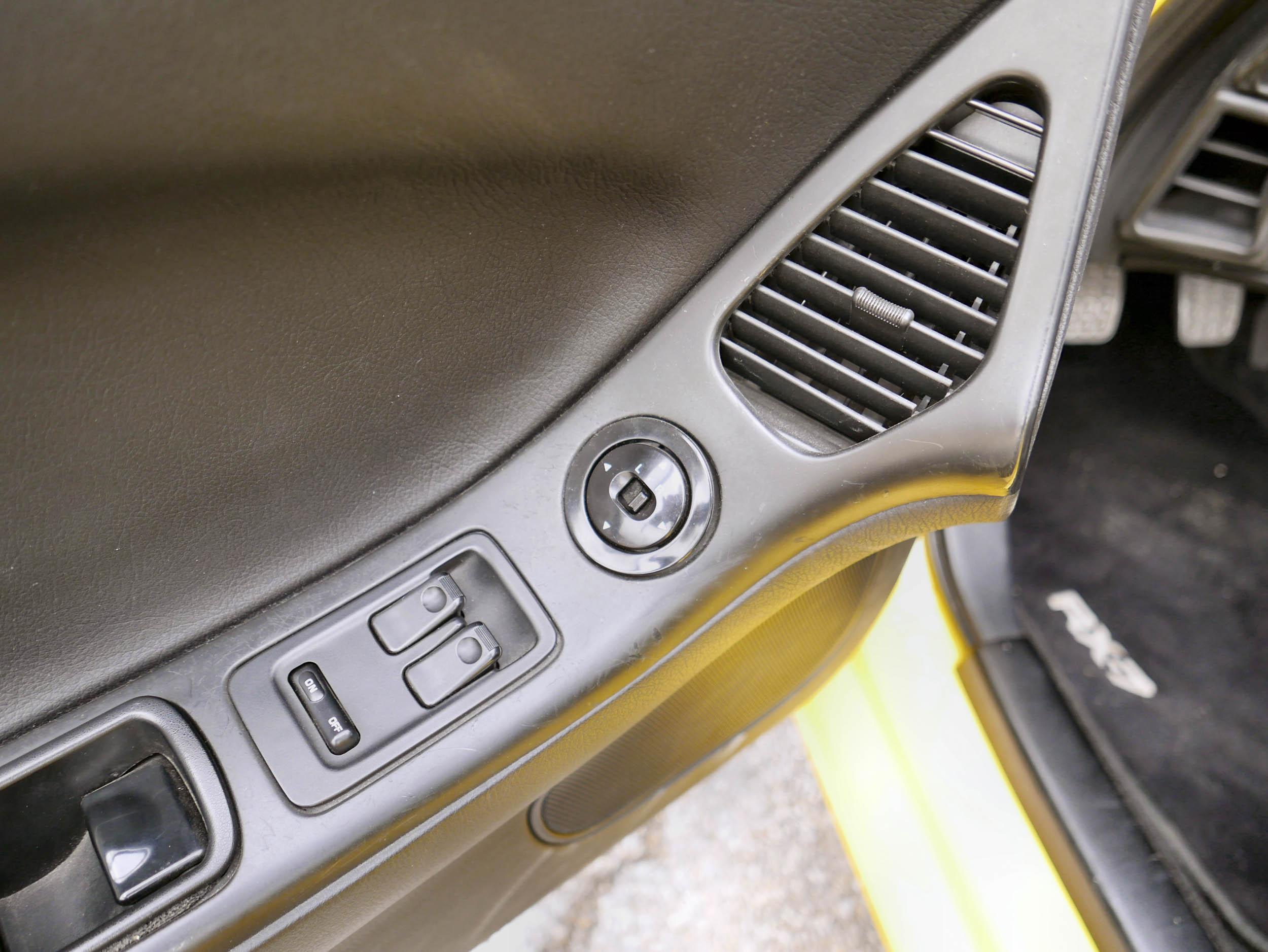 Mazda RX-7 window door controls