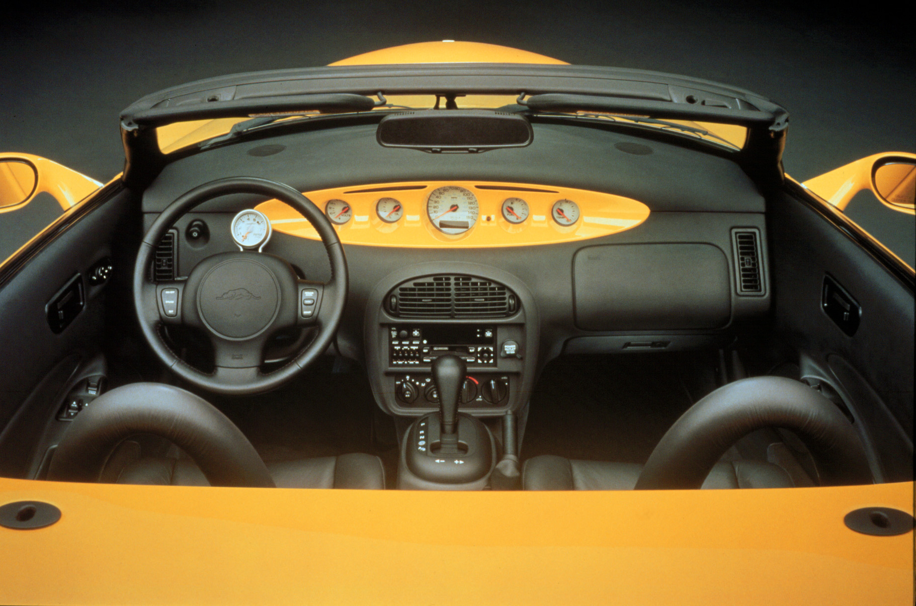 The Prowler's cockpit was simple, uncluttered, and fun, all while borrowing from the rest of Chrysler's extensive parts bins.
