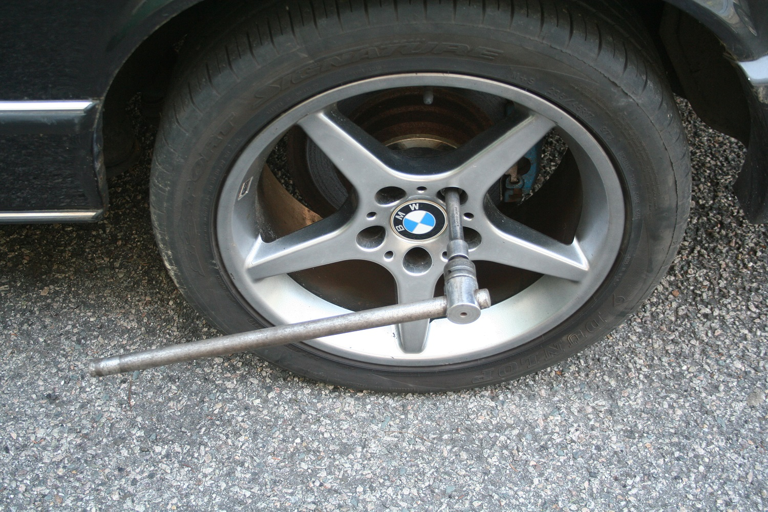 A good breaker bar is way better for cracking lug nuts loose than the flimsy lug wrench that comes with the car. BMW Wheels