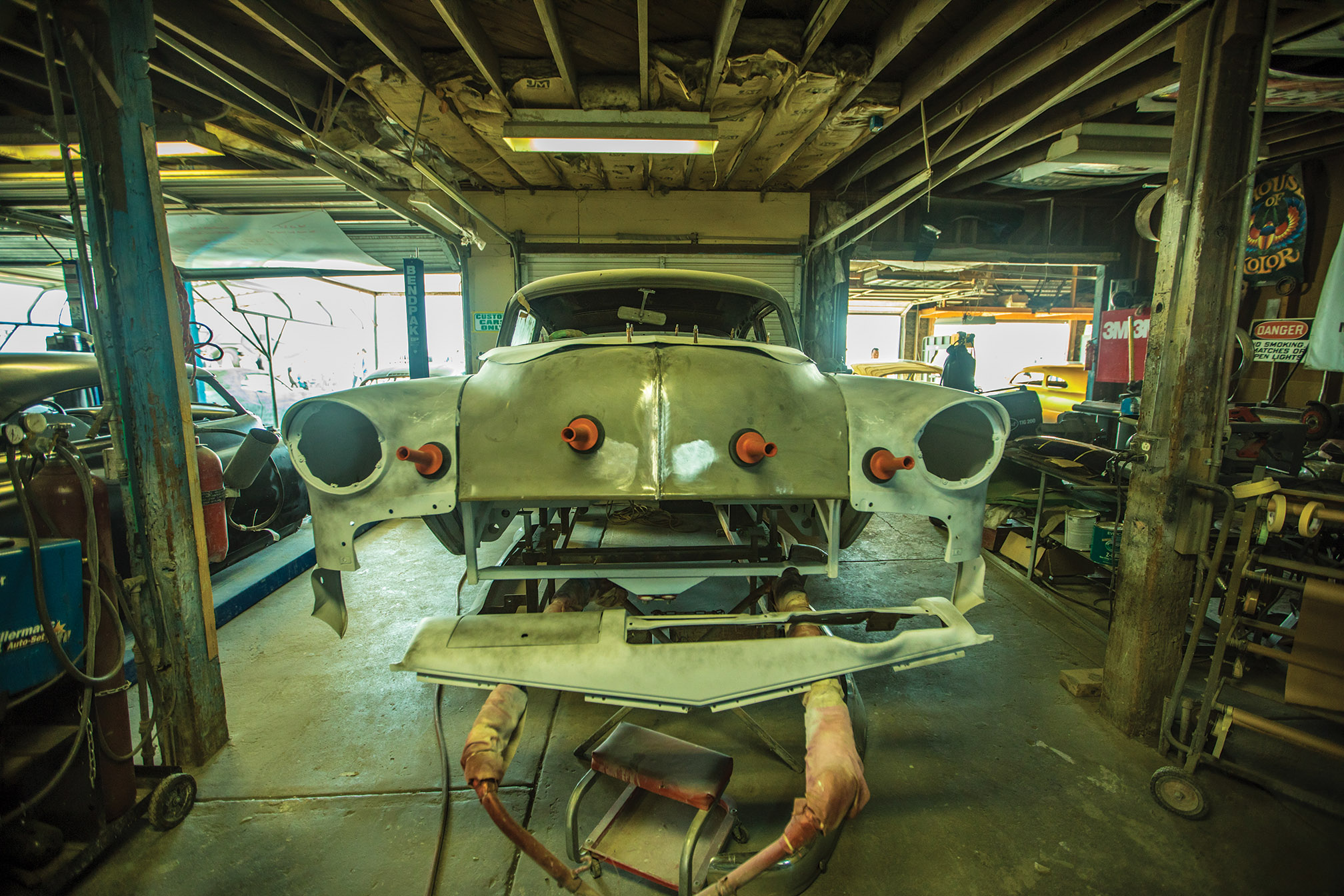 Ready for its facelift, a 1954 Chevy from Australia awaits a front bumper from a '57 Chevy and some reworking of older mods before going under the sander for a famous Winfield Fade paint job.