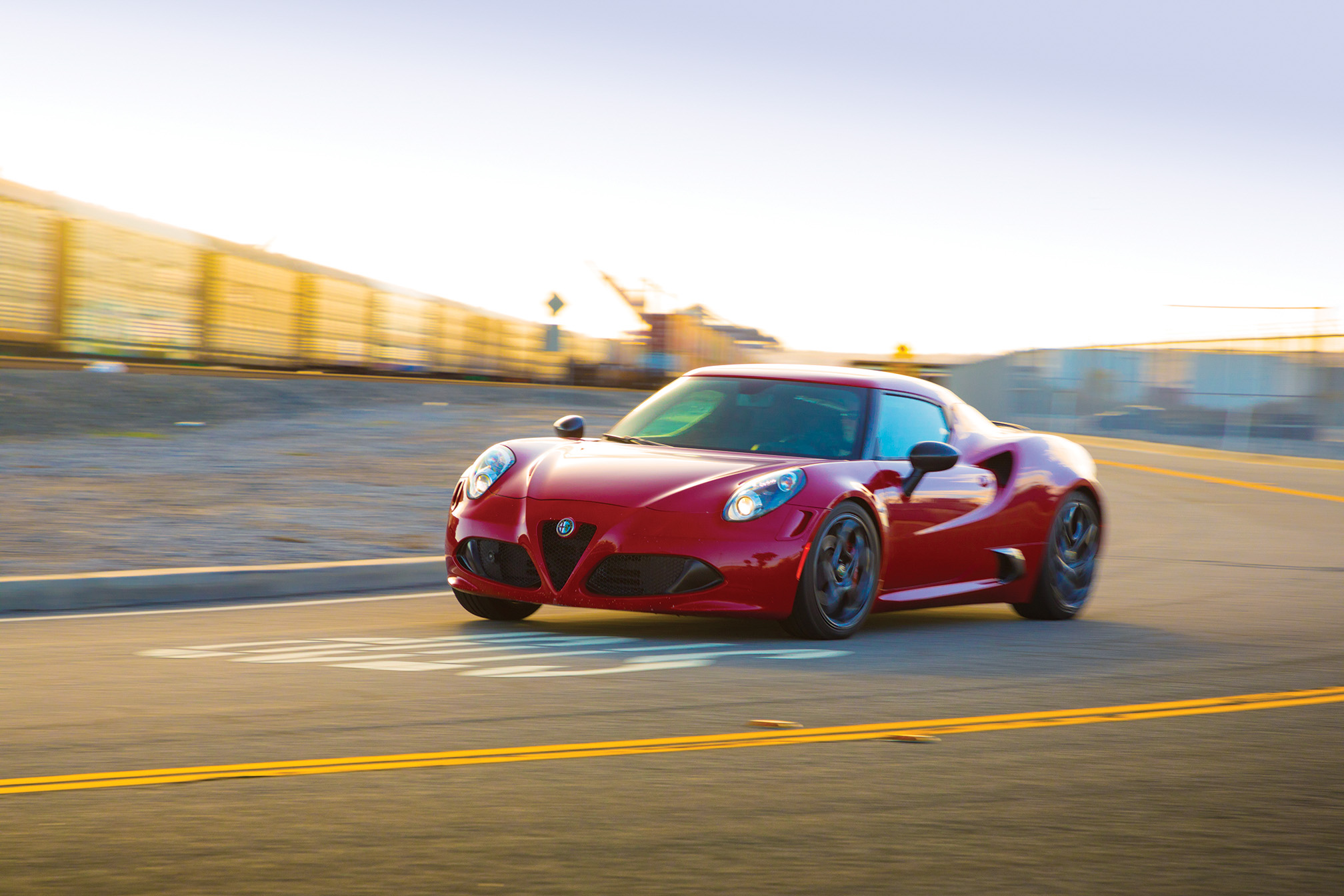 The Alfa lacks power steering—  unheard of in to- day's gizmo-driven  performance cars. But the manual rack reduces weight over the front wheels and  lends the 4C an un- common precision.
