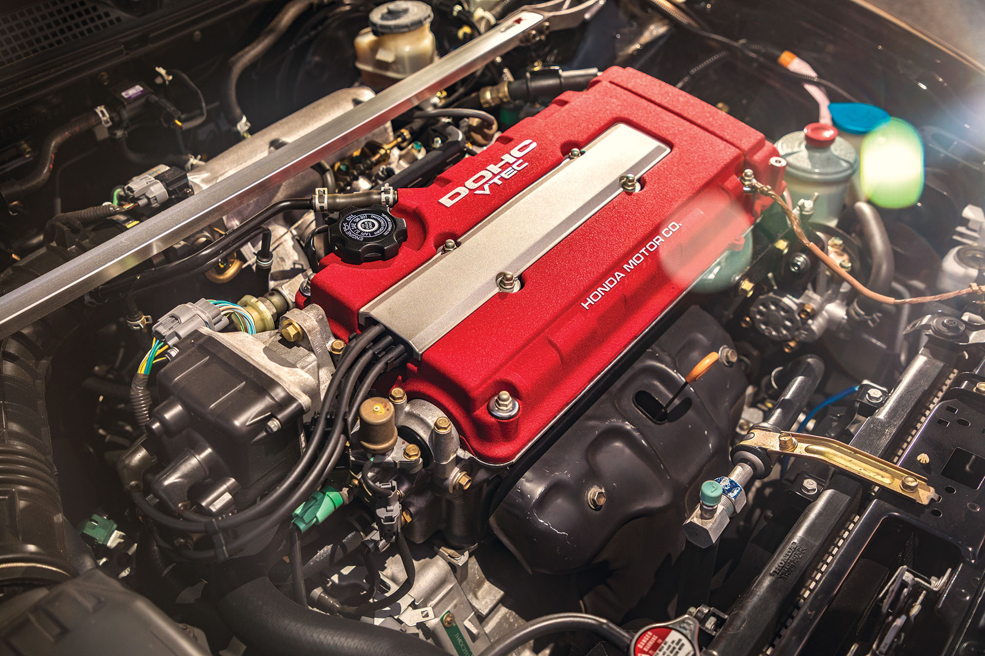 The Type R's 1.8-liter four looks Honda plain, but its high-strength,  lightweight inter- nals; high-lift cam- shafts; polished  ports; and 10.6:1 compression ratio make it sing—all  the way to a race- car-like redline.