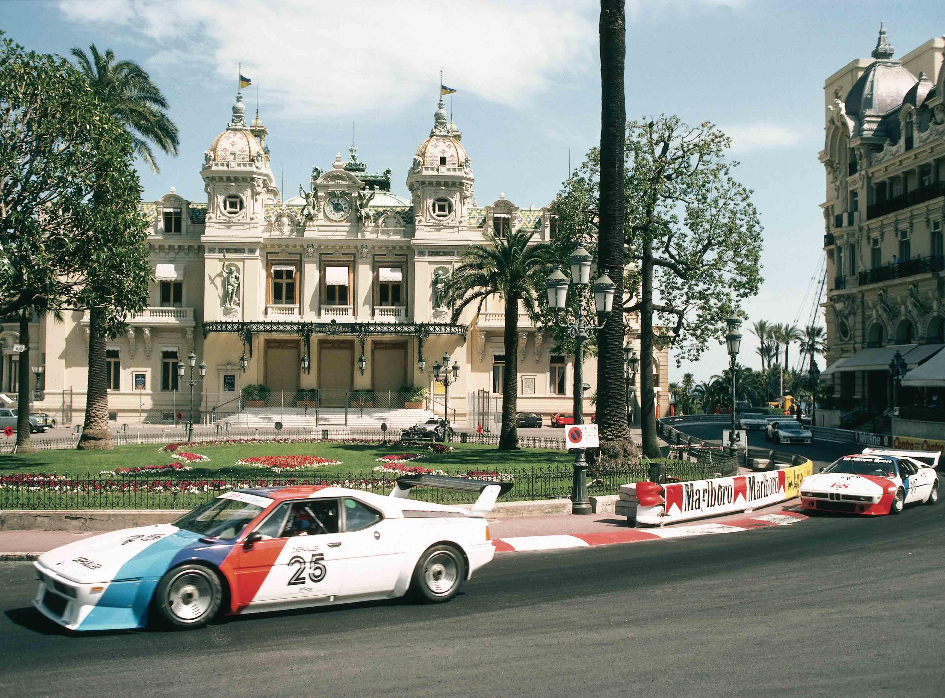 BMW M1 race car side profile on track